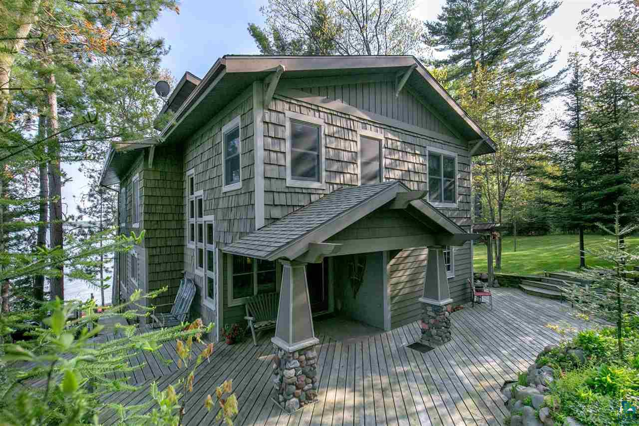 In true Craftsman style, this lake shore home is designed to emphasize the natural surroundings with wood, stone/glass.  Each room in the house has a view of the lake, from the kitchen/sun-room you look down directly at the beach. The neutral interior is the palette for the great lake. Great sunrises with views of Madeline and Long Island, The south view is 3 miles of Bayview beach and the mouth of the Onion River.   Main floor has a large open plan with a spacious foyer, mudroom.  The second floor has three bedrooms, living area, small studio, large bath and tons of storage. 3 Sided decks, Large yard and beautifully landscaped rock gardens with perennials and native plants. A one car garage with area to create an additional drive/garage. With 250? of frontage, This unique property is built on a peninsula and is a nature lovers? dream.  Swim, Kayak, fish, sail, watch the eagles and waterfowl. Near snowmobile trails and 2 miles from Mt. Ashwabay for downhill/cross country skiing. Located between Bayfield and Washburn.