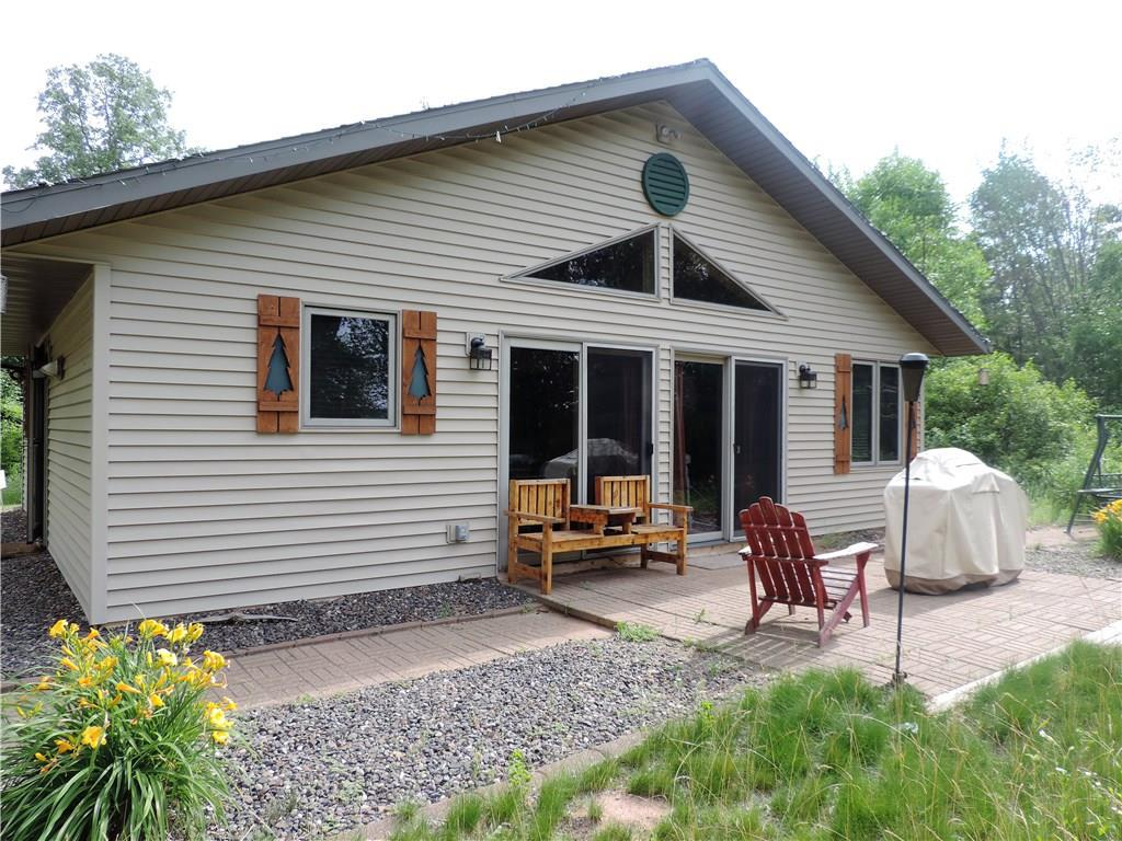 400' of shoreline on east side of Clam Lake near Siren, WI is where you will find this awesome 2 bed-1 bath cabin. Large open yard with perfectly flat elevation to the lake makes this a perfect spot for summer yard games. The 28' x 32' cabin was built in 2002 and has a maintenance free exterior. Interior gives you the up north knotty pine appeal and with new flooring and new bathroom fixtures. Property consists of 4 individual lots so dividing it up would be no problem!