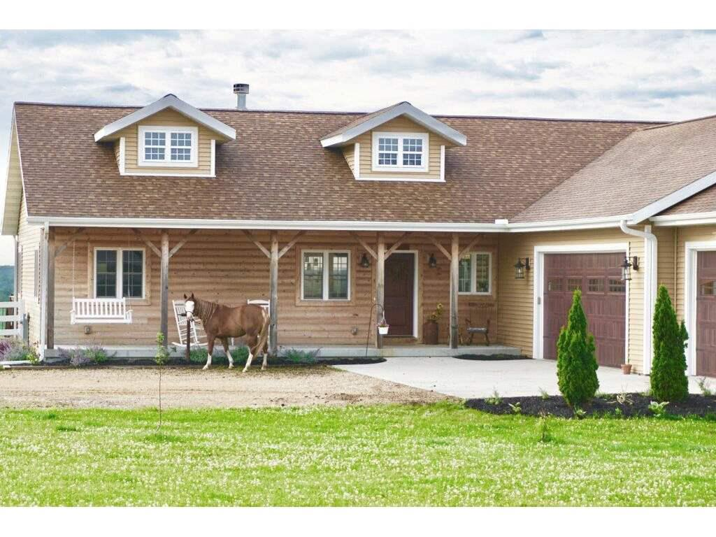 Turn key business and house! Equestrian facility on a dead end road with panoramic views of the countryside and mud lake. Ideal location for horse training, lessons, boarding or private breeding facility. Sale includes 5 bedroom ranch house with Geothermal heat, vaulted great room, custom built-ins and finished walkout lower level. Main level master suite has private full bath and walk-through closet to laundry room. Farm features include 70x70 stables with all electric watering systems, upper level apartment, video surveillance system, and 120x60 indoor riding arena. 35 acres including 22 acres of hay fields. Call for a private showing!