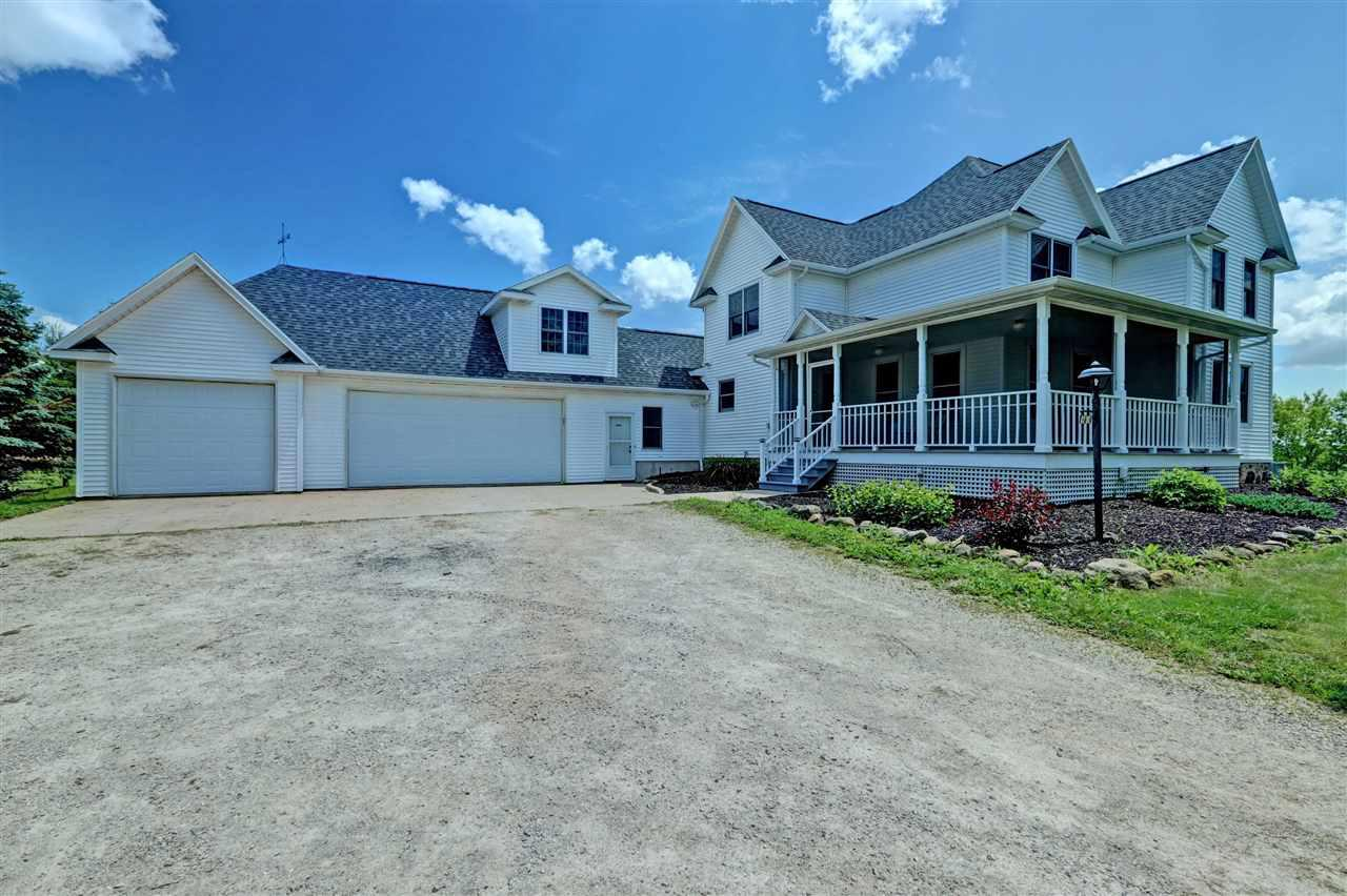 Spectacular property featuring a 4 bedroom, 3.5 bath, 2 story totally updated  farm house. Inside the home you will find a nice sized great room with a wood burning fireplace, open concept, cooks kitchen, first floor laundry, and a spacious master suite with a sitting area and master bath. Outside you will find a 62x32 barn, silo, chicken coop, corn crib, and the list goes on. Property is located minutes from the Fox Valley. Call for your showing today!