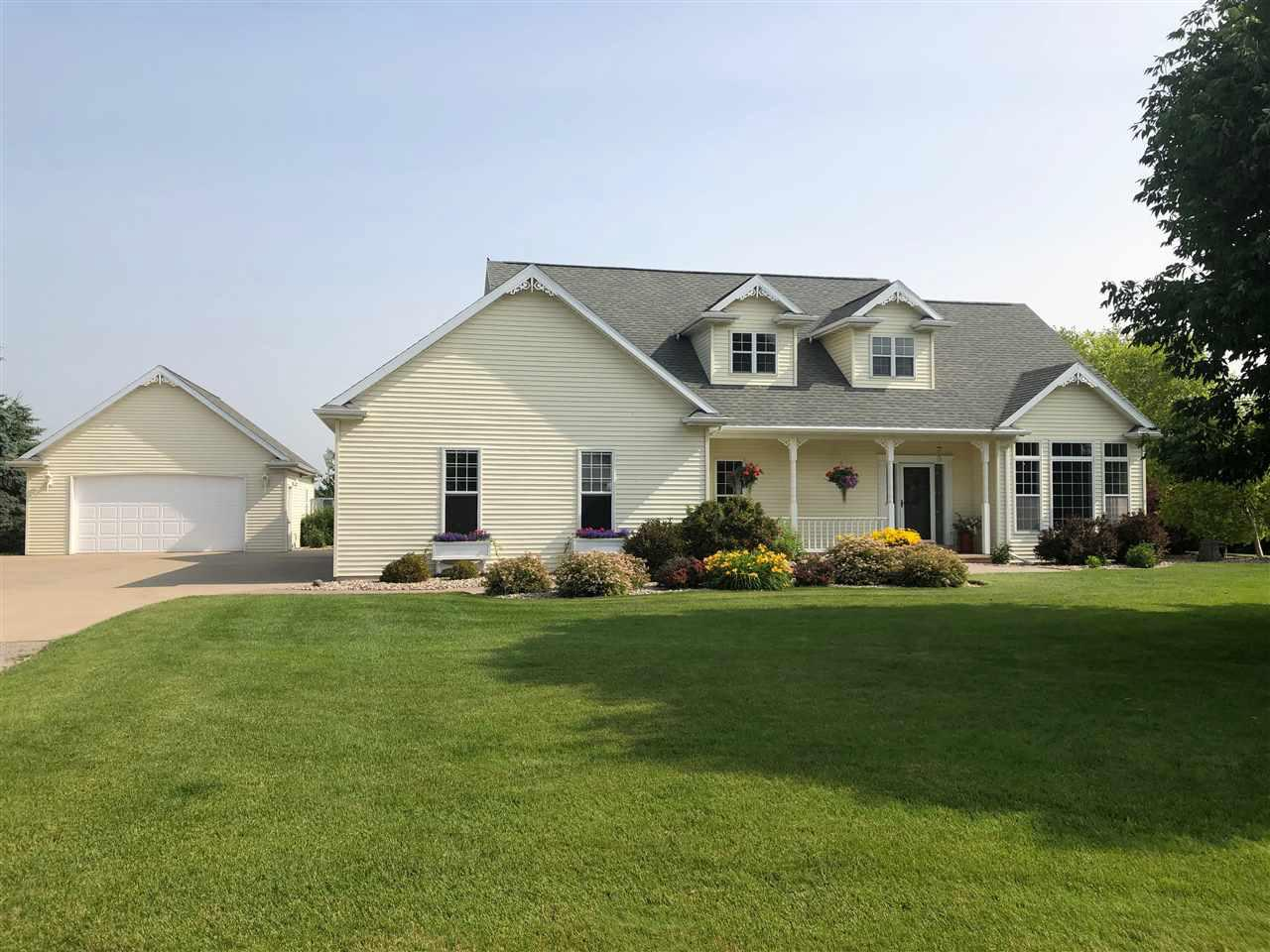 Entertaining at its Best! 4 bedrm 2 Full, 2 Half Bath home located on sprawling 1.76 acres, minutes from amenities. Open concept floor plan. Kitchen appliances included, granite counters, pantry & hardwood floors open to spacious living room, gas fireplace with lots of windows for natural lighting. Dining area has wall of windows and view of private yard. st floor office. First Floor Private Master Suite, jetted tub, shower, double sinks & walk in closet. 1st fl laundry w/sink. 3 bedrooms, loft area and separate office/game rm. 2.5 det garage-heated.Shed.Steps Garage to Basement.Patio.FirePit.