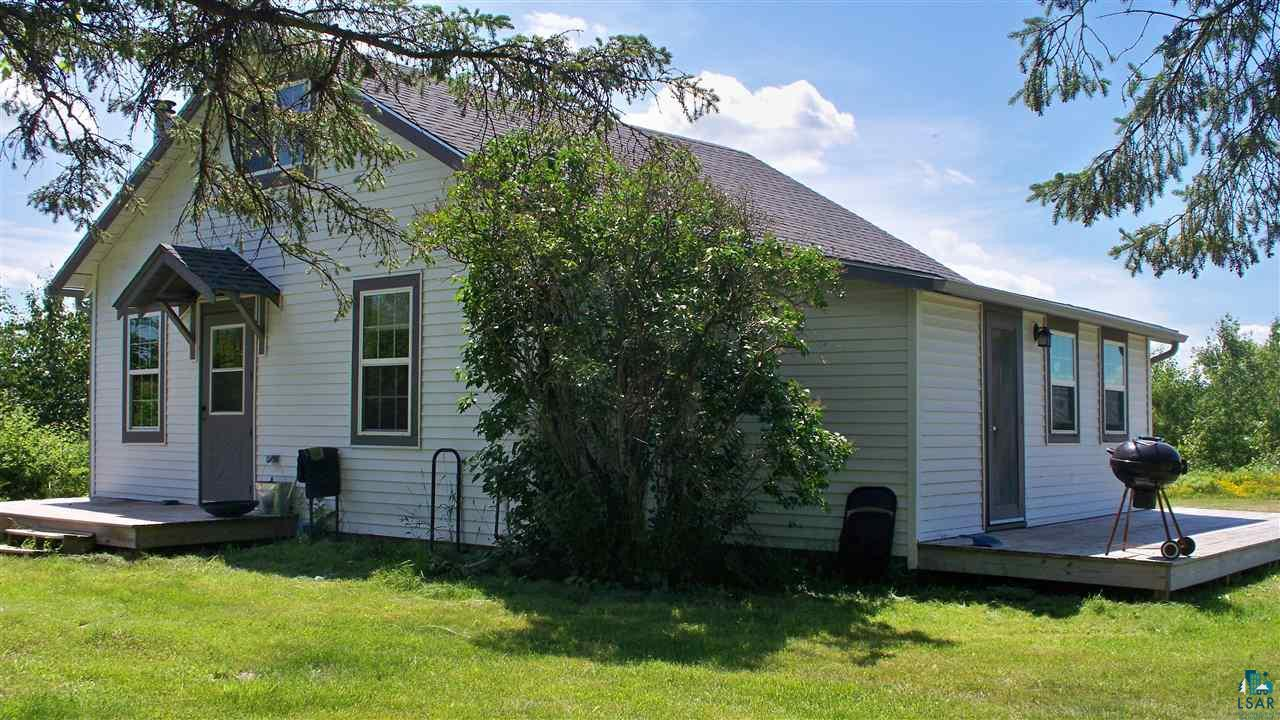 Looking for an up-North get-a-way? This charming country home may be right up your alley, with 5 acres of peaceful living and just a short drive to the twin ports. Main floor features, bedroom, full bath with stacking washer/dryer, kitchen, dining and living area. Second floor is wide open area for master bedroom or can be divided to make 2 bedrooms. Enjoy a cozy wood fire with in freestanding wood stove which is included. 2 nice decks ready for sitting outside and enjoying the sounds of nature. (Out buildings on property have little or no value). Property has been surveyed.