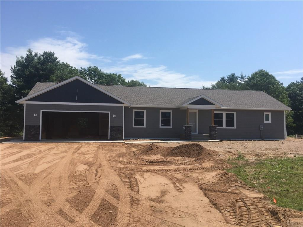 New construction on the Cranberry Flowage.  Great neighborhood with fishing right out the back door.  Estimated completion date mid August 2019.  Home has smart siding, open concept with vaulted ceiling & main floor laundry room.  Separate master suite with tiled shower on main level, hickory floors, granite countertops in kitchen & bathrooms.  Lower level partially finished with walkout, 1 bedroom, 1 bath & family room.  Interior photos are of a spec home previously built & sold.