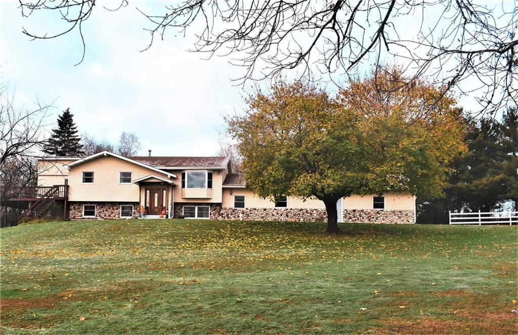 You must see this Hobby Farm on 7.5 acres! 50x70 pole barn with 3 horse stalls, tack room & water. Beautiful white fencing & views of large pond. Just 1/4 mile to Bass Lake! Enjoy it from 24' Octagon 4 season gazebo! Other 32x60 shed has workshop inside. 4 bedroom - 3 bath home has walk-out lower level. 93' of deck on 3 sides plus patio. Large entrance room has sauna & family room setting. Cozy lower level family room has gas fireplace. New flooring, windows, siding, shingles, granite counter tops & addition in 2008. LP tank is owned! New central air, range & refrigerator in 2018. Room off garage has electric & ready for hot tub.