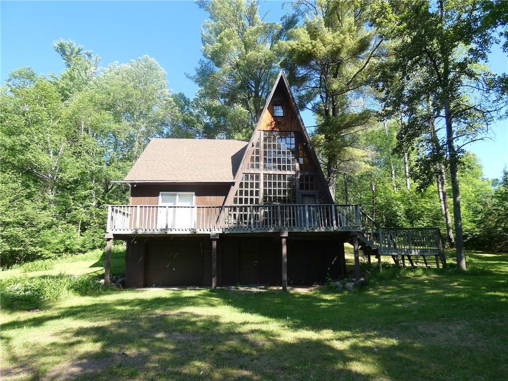 Chippewa River - Great 3 season one of a kind cabin. This tailored A frame with approx. 390? of frontage is very private and sits on a beautiful 3 acre park setting with large level yard to river frontage. Cabin offers 3 bedrooms and 2 baths with one bedroom and laundry on main level, wood floors and wood walls throughout main living area. Large wall of windows and multiple decks to take advantage of the great river views. Many recent updates. New roof in 2015. Home is handicap accessible.