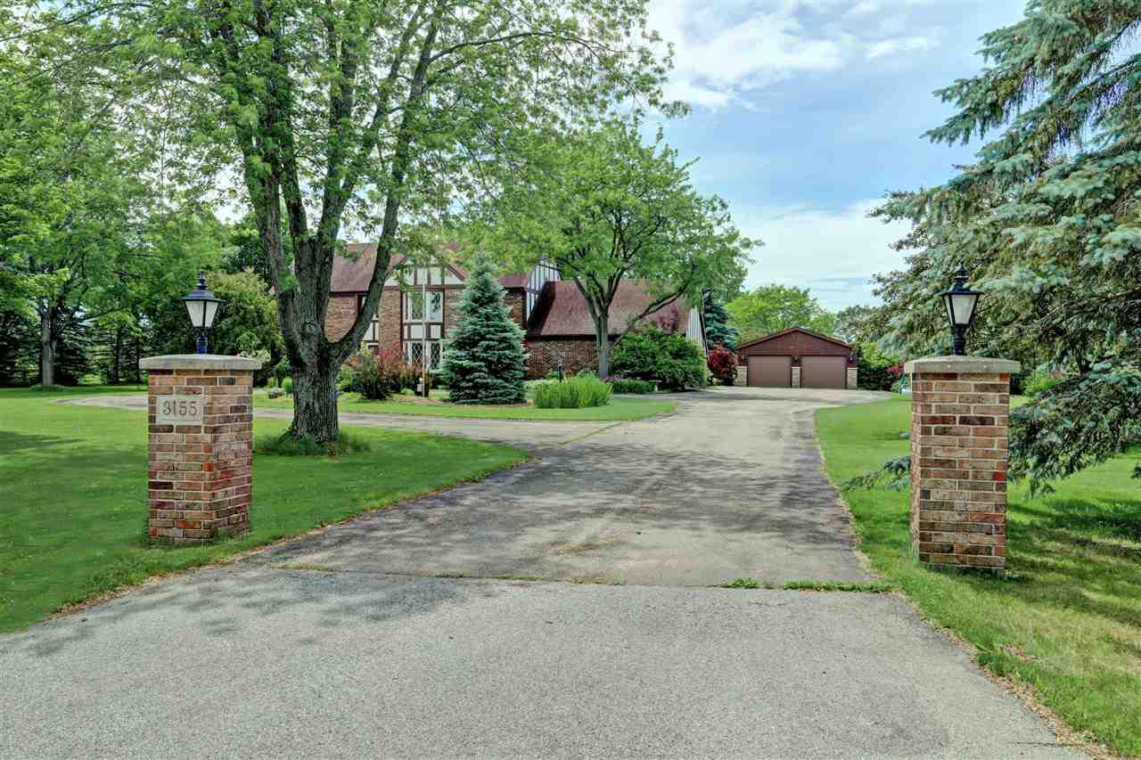 Luxurious Estate property located west side of Neenah, minutes from the City and 2 Golf Courses. House has a ton of updates (see attachment). Massive country kitchen offers space for everyone, 1st floor laundry and a 1st floor office so you can work from home. Finished lower level with a finished wet bar including refrigerator. Private in-ground heated pool 3 ft gradual slope to deep of 9 - 9 1/2 feet w/diving board. 2.42 acres well maintained and landscaped. 2 garages to offer space for all the toys to come. Master bedroom offers a balcony that overlooks the pool and patio area.