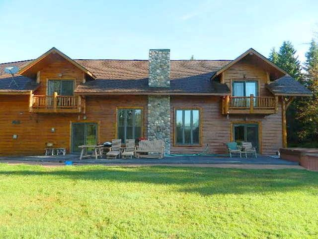 Custom Home with private gated drive on 113+ acres of woodland meadows, filled with wildlife and private pond. Home filled with many custom details including outside decks, patio w/hot tub, geo-thermal heating/cooling. Many opportunities on this property with large attached garage that is finished and heated. 32x54 Metal bldg, barn and additional storage building.