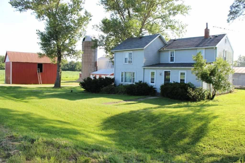 This Farmette with 1 1/2 story fixer-upper farmhouse and several outbuildings on a 34 acre parcel with a mix of tillable, pasture and wetland along Grassy Lake. Located on the outer edge of the Village of Doylestown, just east of Rio, and less than 30 minutes North of Sun Prairie. Currently used for a few cattle it may also be best utilized by a horse lover that needs more space and buildings to enjoy their hobby. The home is ready for a makeover so bring your vision and restore the charge. With all of the outbuildings and open space you will have the opportunity to make your dream come true.