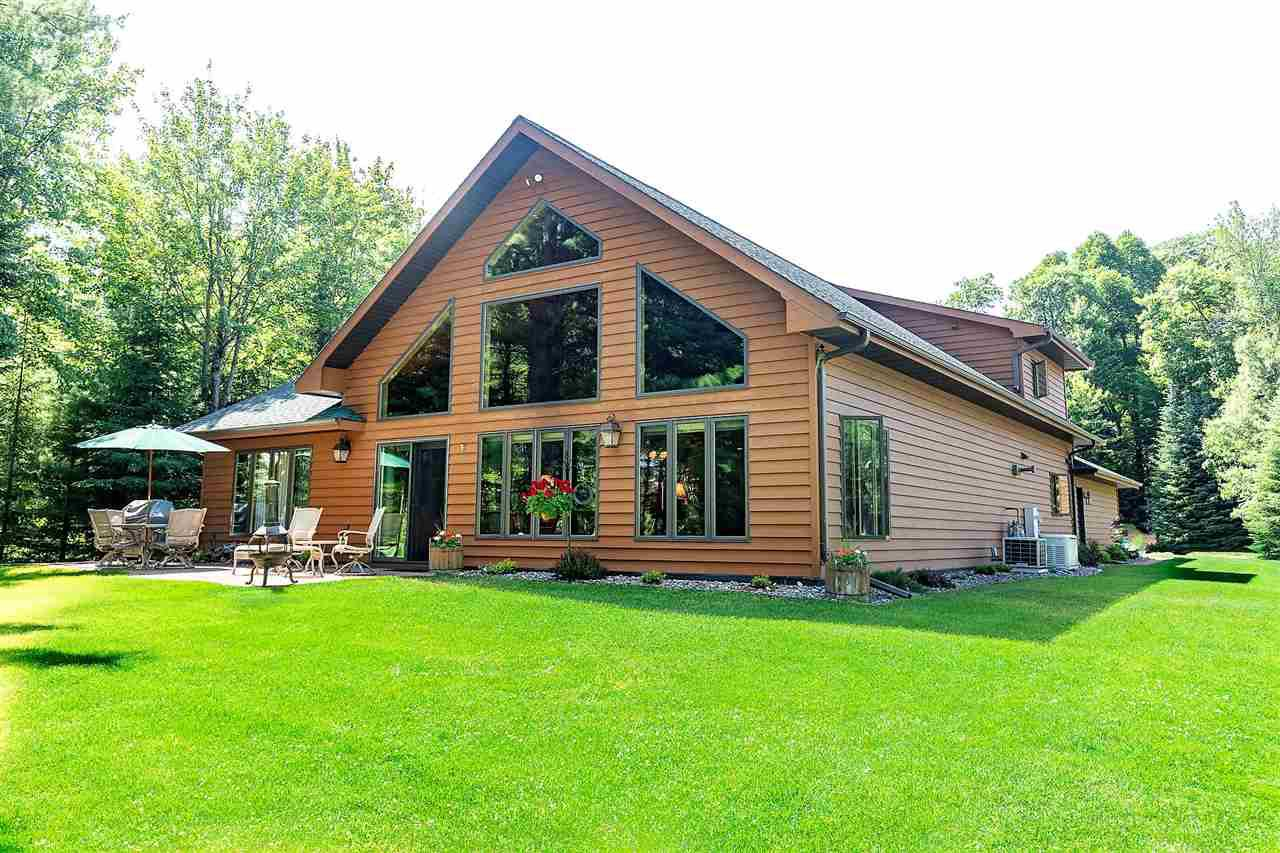Look no further than this GORGEOUS home located on Otter Lake on the Eagle River Chain.  Main House has lake views that are breath taking.  Built with knotty pine woodwork throughout, 6 panel doors, and tongue and groove vaulted ceiling in great room/loft.  Like having company without them staying in the main house?  No problem, there is an additional 972 square foot living quarters in your own guest house within walking distance that features an additional kitchen, family room, bedroom, and full bath.  Need room for all your toys?  See detached 4 car heated garage.