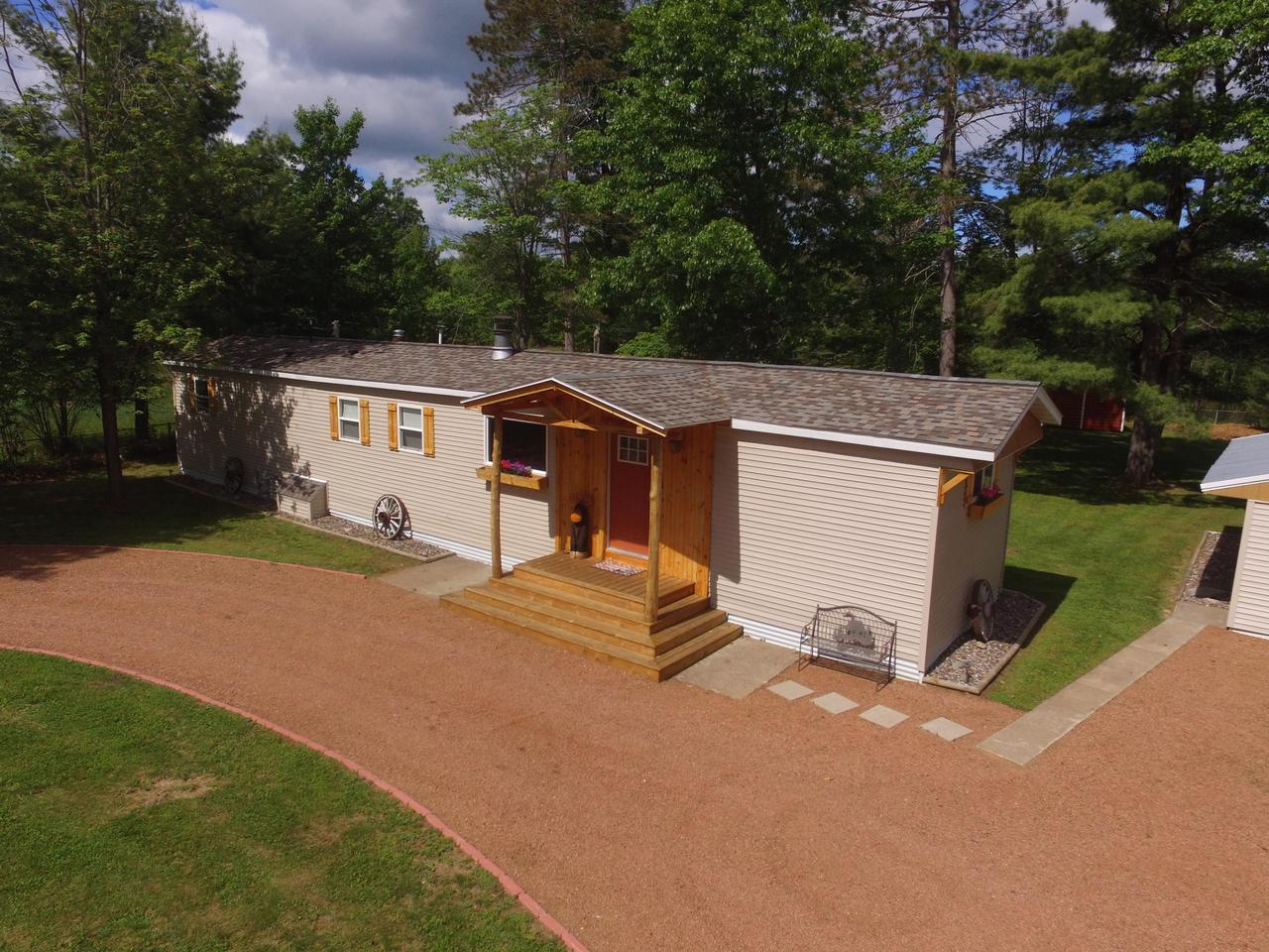 Come check out your Northern Wisconsin retreat!  completely remodeled in the last 3 years, Sitting on a half acre lot with a park like setting it just gives you those relaxation feels.  It's got 3 bedrooms and 2 full bathrooms, storage shed and a 2.5 car garage.  You've got to check it out, schedule your private showing today!