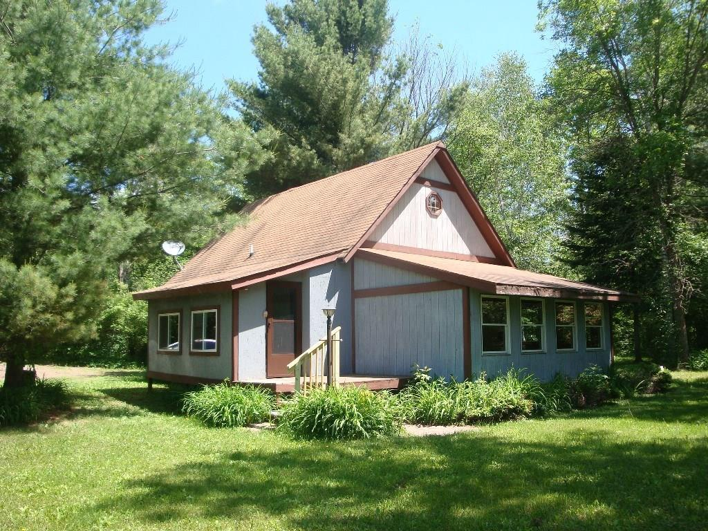 Great recreational location in the Red Cedar Lake area.  This two bedroom one bath cabin has two usable lots totaling over an acre.  Great cabin retreat or starter home!