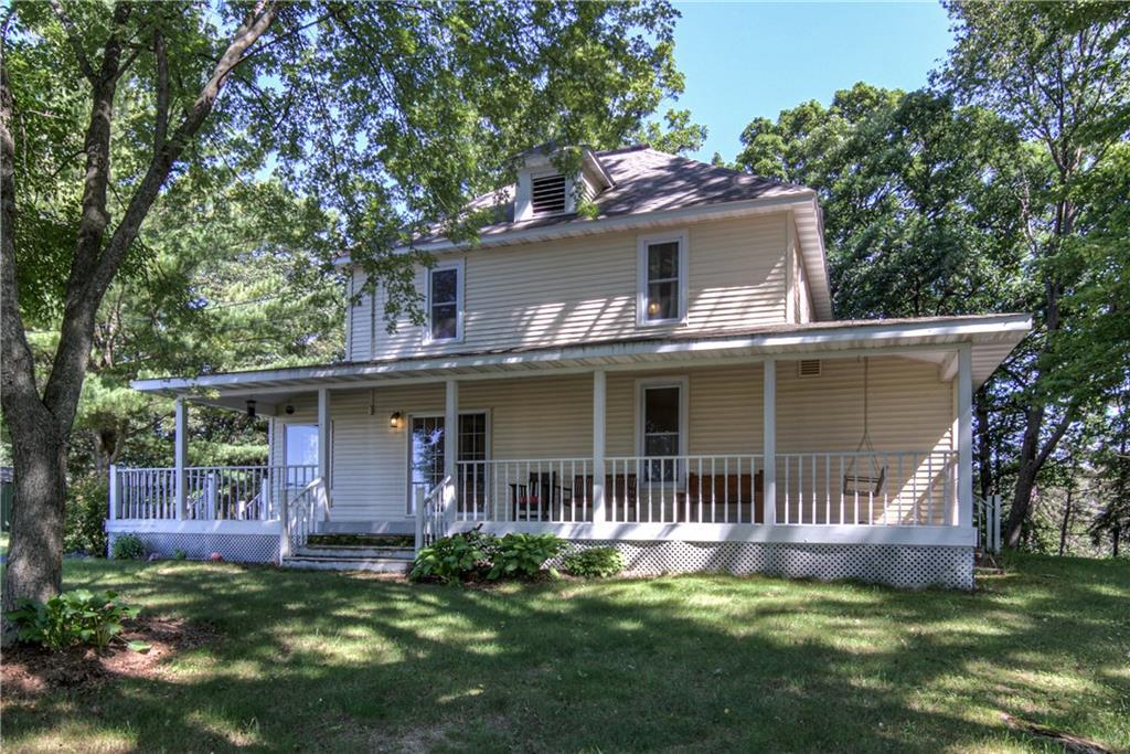 4 Bed 2 Bath Country Farm House on 5 acres with beautiful country views. Original Hard Wood floors,open staircase, newer double hung windows, remodeled kitchen and bathrooms. Bright south west facing sunroom entry plus additional office/guest bedroom space. Covered wrap around porch, 3 car garage, small barn with loft, pole shed/workshop, potting shed and more! Great Hobby Farm potential! Apple trees, raspberry bushes, fire pit, pasture land, woods and trails on property