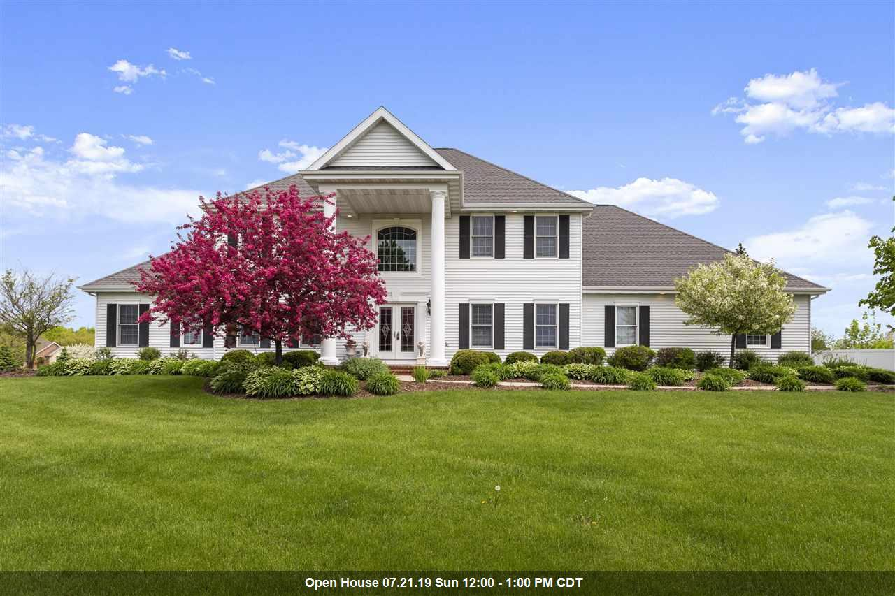 This GORGEOUS home on 1.19 acres is ready for you to move right in!  You will have plenty of room with 5 huge bedrooms and 5 full bathrooms.  The kitchen is a chef's dream with quartz counters, gas range and loads of cabinet and pantry space. Serve your guests in the dining area or formal dining room.  There is a formal living room, family room with gas fireplace and beautiful sunroom to relax all year long.  You and your family and guests will also enjoy the amazing theater room and rec room with eating area and full wet bar!  If you've dreamed about it, this home has it.  Must see!