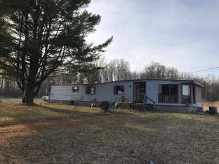 Ideally located partially treed flat 2.23 acre building site with well, septic, electricity, propane already in. Mobile home needs repairs before occupancy. Perfect for the handyman! Trash by previous renters scattered about. Seller encourages inspections but is selling everything ?as-is.?
