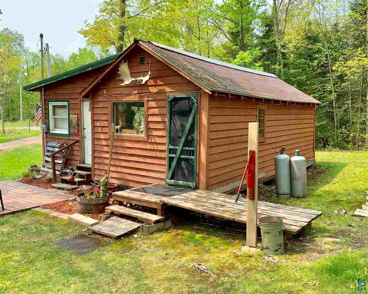 Sportsman's Getaway! Seasonal cabin on 20.6 wooded acres 2 permanent deer stands on a trail. Lots of ATV trails in the area, plenty of grouse. Heated with wood stove, electric service with circuit breakers. Out house biffy, no well or septic. 30 Minutes south of Superior.