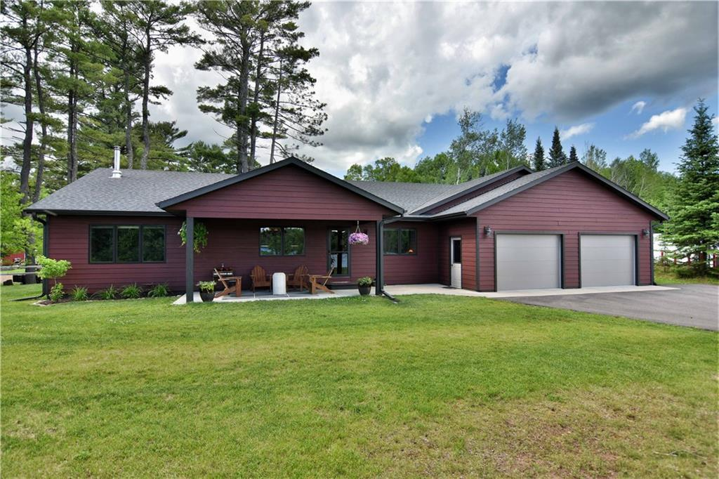 Built in 2016, this 3 bedroom, 2 full bath home on Lake Namakagon has been immaculately maintained and remains in like-new condition. Smart, open floor plan offers convenient, single story living including large, attached 2-car garage. Enjoy a beautiful view of the lake from the covered front patio, and beach and dock access via common grounds and shared lakefront area. Quality construction offers low maintenance living so you can enjoy your time at the lake! Convenient location to Lake Namekagon restaurants with snowmobile and ATV trail access right out the front door. The spacious interior features beautiful flooring throughout, custom cabinets, high ceilings, wood burning stove, and an open kitchen with island seating. Large master bedroom suite includes walk-in closet and full bath. Plenty of closets and over-sized garage for storage. Get ready to live conveniently at your new lake home!