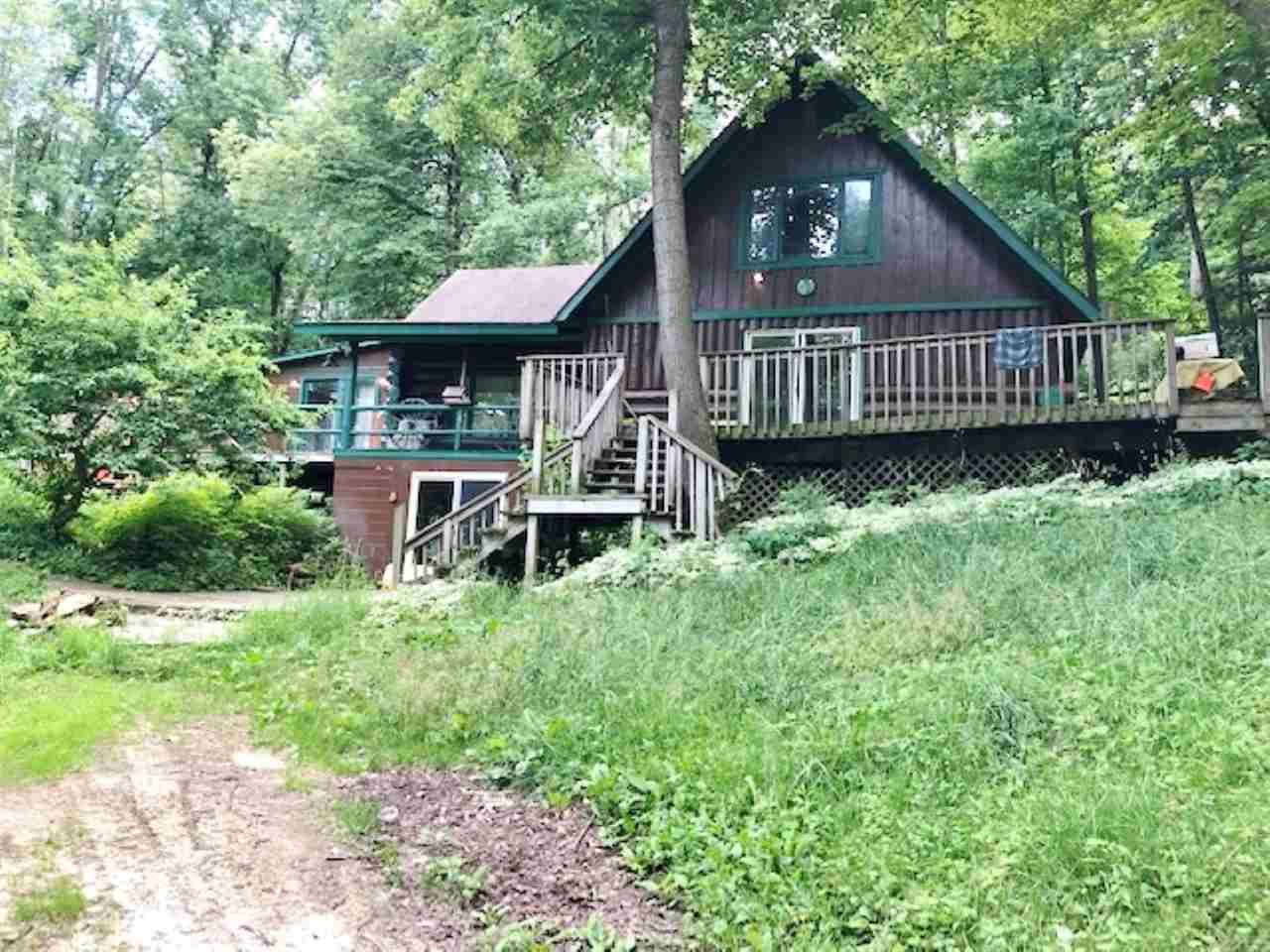 Log Home On 9 Acres Of Privacy! Hobby Farm, Set Up For Horses, Or Other Animals If You Like!  Full Log Home With Walk Out Basement.  Small Barn, Out Buildings, Detached Two Car Garage, Dog Kennel.  With A Little TLC You Will Have A Great Property!  The Location Is Fantastic - Take A Drive And Check This Property Out.