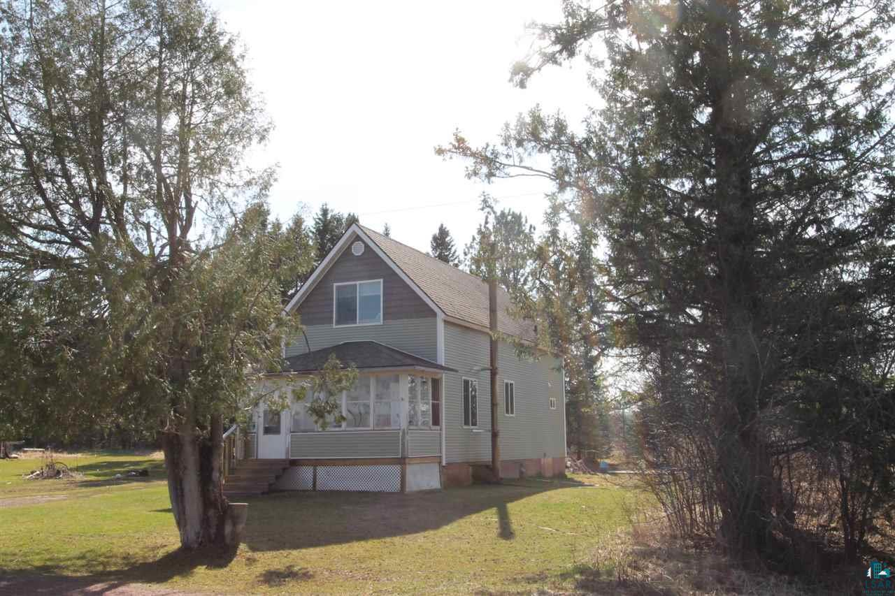 Could be the perfect Hobby Farm within minutes of city limits.  3 bedrooms, 1 bath with an enclosed porch.  Approximately 30 acres with 10 wooded and 20 acres of open farmland.  Roof, siding, windows, soffits all new in 2012.  New Holding Tank in 2018.  Older outbuilding with an additional heated chicken coop.