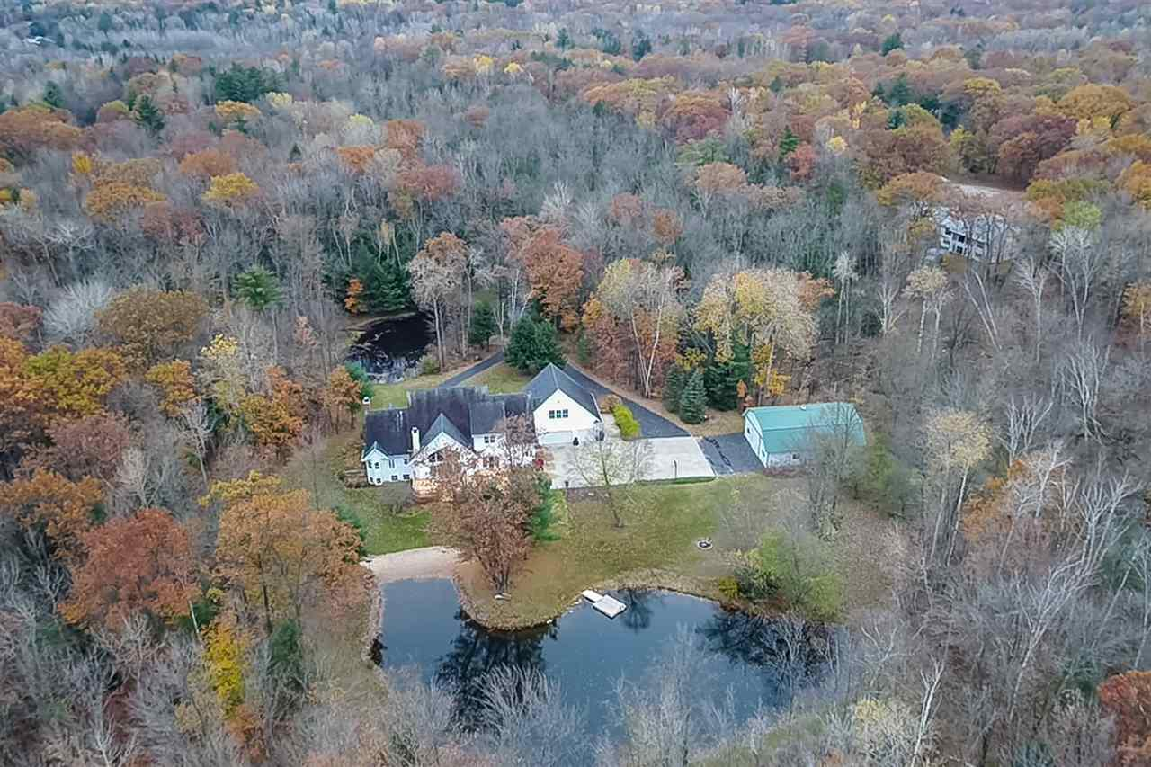 Unique property that will exceed your expectations & can be used in so many ways;  a vacation property (you'll never leave home again),  recreational paradise, equestrians dream, AIR BNB possibilities w/ a short drive to Green Bay's Titletown District!  12.9 Wooded Acre Retreat has 2 ponds (certified fishery & stocked/spring fed pond) wildlife galore, abuts the reforestation park trails, horse trails, snow mobile trails, walking trails, yet very private! 3 Master Suites each w/own private bath, 3+ other bdrms, huge kitchen & great room overlooks woods & pond. Call for List of Amenities Today!