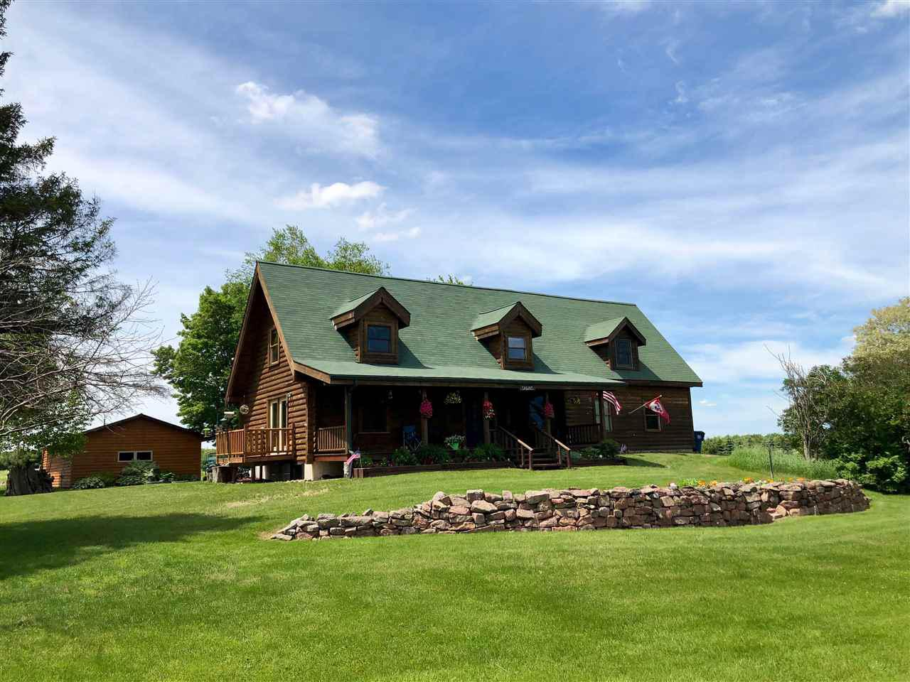 Stunning log home on 17-acres w/ abundant wildlife! Convenient location, close to town, yet private, offering a tranquil escape. Meticulously maintained including 3 separate fenced in horse paddocks, 3 stall barn w/ running water, heated tank w/ electricity, & covered hay storage & outside shelter. Stunning interior w/ loft overlooking the large vaulted living space w/ rustic cabin feel. DIRECTIONS: Hwy 52 East to Cty Rd J, E on Granite Rd, N on Trappe River Rd. OLD ADDRESS: T9322 N 97TH ST WAUSAU, WI 54403,Exceptional craftsmanship and quality of this Tennessee log home built in 2001 include the large wood vaulted ceilings in living space flowing into dining space, kitchen with custom cabinets and sliding doors to side deck, spacious bedrooms upstairs with warm cabin feel, large lower level family room good for entertaining, and a very spacious laundry room. Relax on the large front porch and enjoy the sunrises and abundant wildlife including turkeys, geese, other birds, deer, bear, coyotes, fox, and even bob cats! Additional values include fresh log home stain (2017), log home roof (2017), attached, insulated 2-car garage (2007), detached, insulated garage (2007), heated/ insulated workshop (22?x14?), newer cedar sided and painted horse barn (2017), insulated horse barn (2007) w/ water line 5? deep, high efficiency furnace (2007 w/ maintenance completed in 2017), A/C (2007 w/ maintenance completed in 2019), new septic pump (2016), new well pump (2007 -  depth 101?), and newer water heater (2016). Additionally, the old barn foundation could be used for a swimming pool / hot tub and includes a 220 electrical outlet, plus the old silo set up for fire pit, great for entertaining!