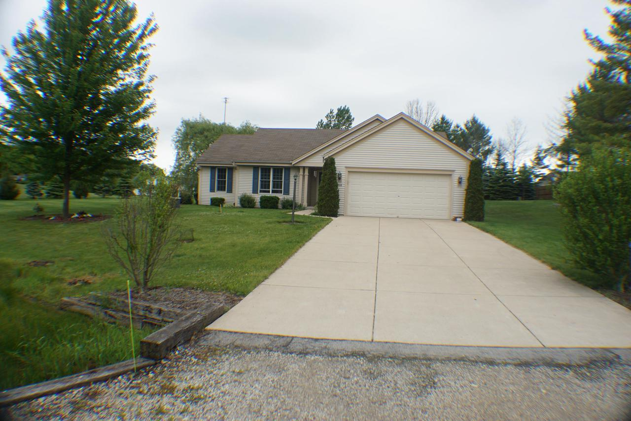 Wow! A newer ranch home in Grafton under $300K! This is a newer (early 2000s) well cared for home with a full acre lot with lots of privacy (corner lot) and room to roam. Open floor plan, two full main level baths with ceramic tile, large master with WIC, mudroom which could be main level laundry, pantry, gas fireplace and more amenities adorn this great pick. Fully finished basement includes half bath, wet bar and extra large rec room! Central humidifier & softener included. Additional detached 2 car garage/storage. Don't wait, schedule your showing today before its gone!