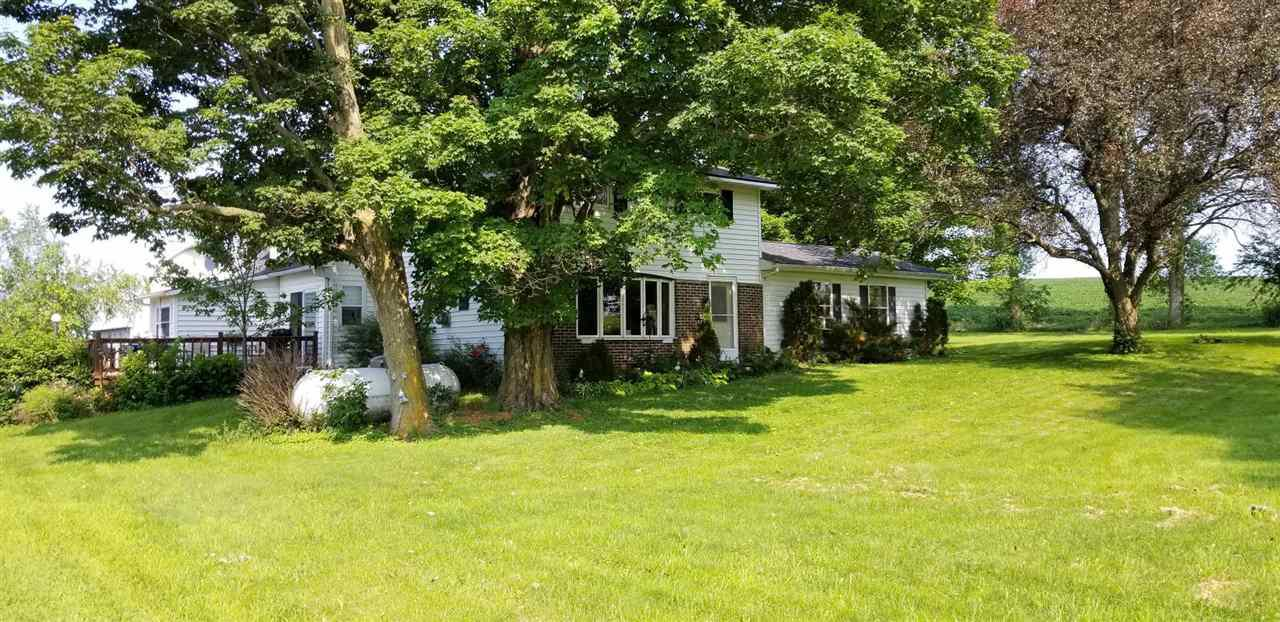 Neat, clean farm home on 5.76 acres. 3 bedrooms plus 2.5 bath, updated. Master bedroom addition 8 yrs old. Newer kitchen and flooring. Gas fireplace. 14x15 screened in back porch. Paved driveway, 1/4 mile of creek, move in condition. 24x24 detached garage and 32x36 barn for toys. 2 miles to town. 3.99 acres zoned residential, 1.77 acres ag. Seller keeping 3 acres. Please see aerial. Taxes of $2833 are for 3.99 acres! Est taxes for 5.76 acres - $2900 for 2018. Well 2 yrs old, septic older. Reassessed in 2018.