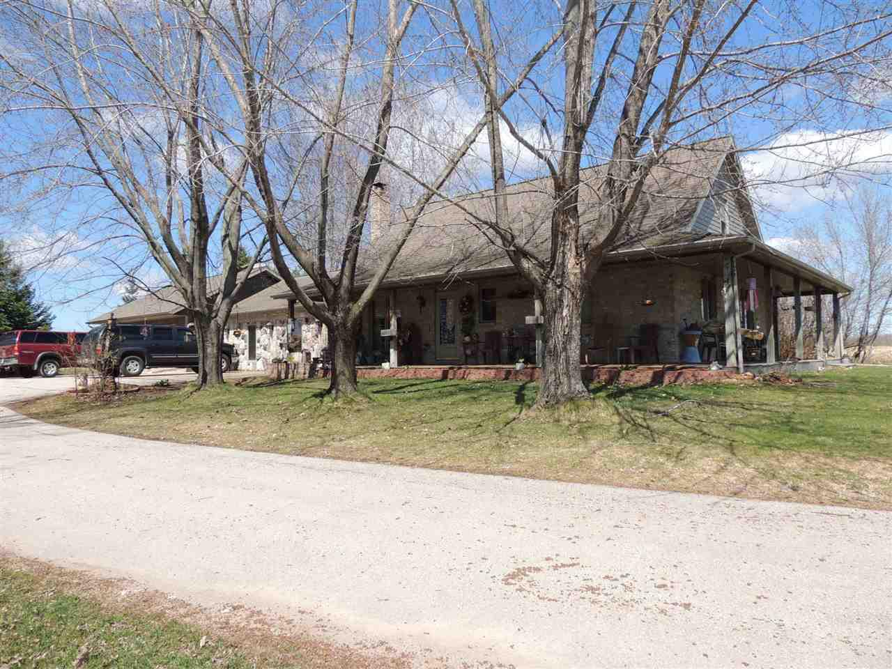 Farmette located on aprox. 6 acres. Large 100'x50' shed with about 1/3 with cement. Shed is partial insulated and has work shop. Barn needs some TLC. Additional 50 acres of ag land may also be purchased. Living room can easily be sectioned to make additional bedrooms. Home has some hardwood floors, two sided fireplace, pellet stove,and large kitchen with snack bar.  Home is currently on 25 acres zoned ag. if buyer only wants the home and aprox. 6 acres it will be surveyed off of the parcel and possible rezone to residential.