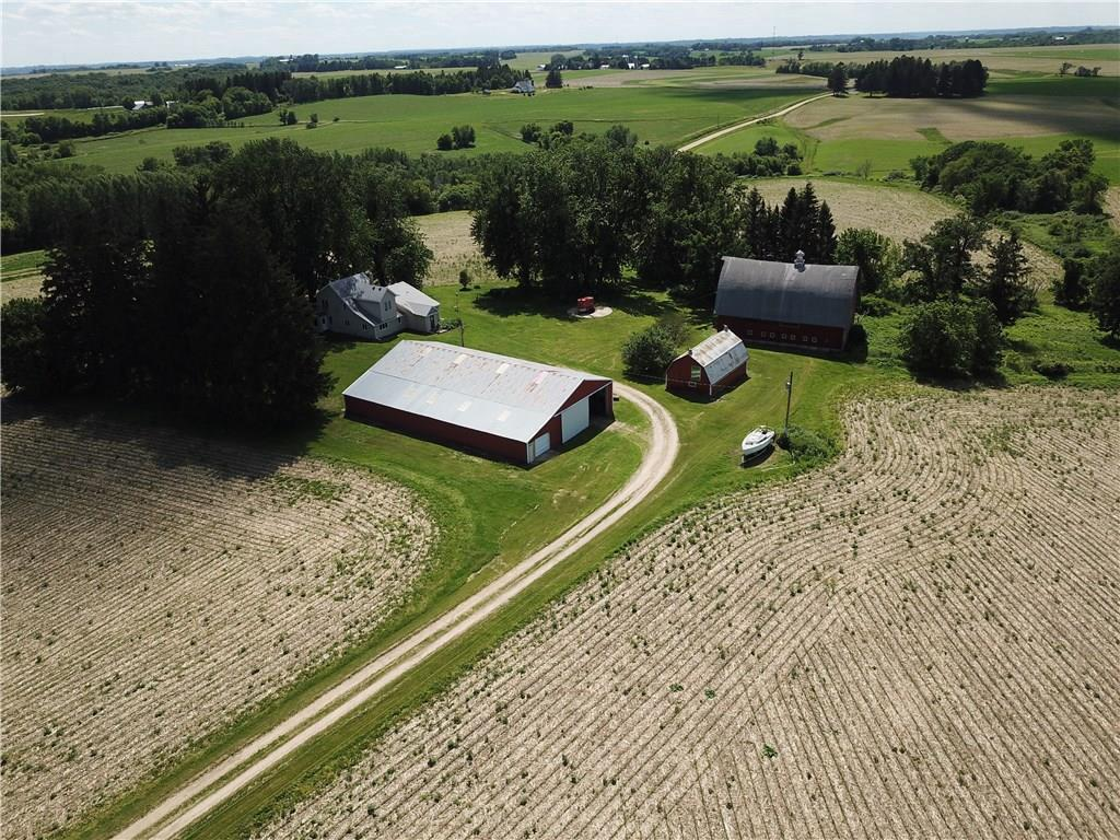 Roomy farmhouse on 39 acres w/ tradition barns. Completely Updated w/ kitchen, separate din rm & pantry. 2017/2018 appliances, water heater, boiler, well pump. Separate dining rm. 5 bdrms w/3 downstairs. 2 baths down, one off the mstr bdrm.  Up has full bath, spare rm going to deck is wired & plumbed for kitchen if desired. Full deck around house, entrance for hot tub ($12,000) thru master or outside deck.  Lg traditional barn 34'by 60', smaller barn 20' by 36' & huge pole barn 55' by 90.