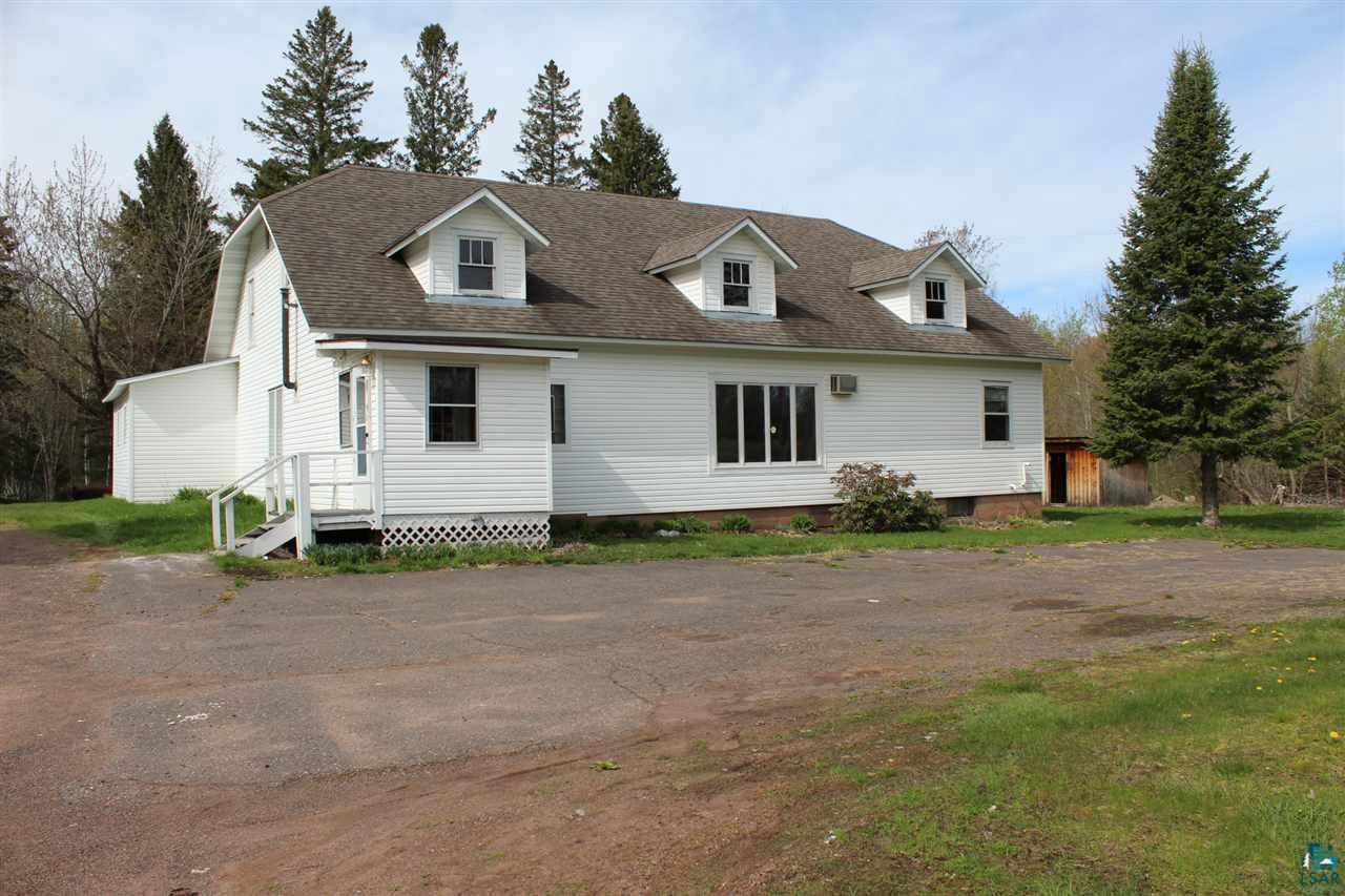 This unique country home on five acres that has an over-sized floor plan which creates opportunity to convert into any number of businesses or to continue to use as a single family home. Spacious Living and family rooms.  Conveniently located on Hwy 13 just North of Mellen.  Outbuildings could be used for a variety of uses, including a sugar shack.  A great nature lover's retreat with some cut trails to enjoy year round in addition to excellent hunting opportunities.  Wood boiler system was put in by owner. Home is in need of some TLC.