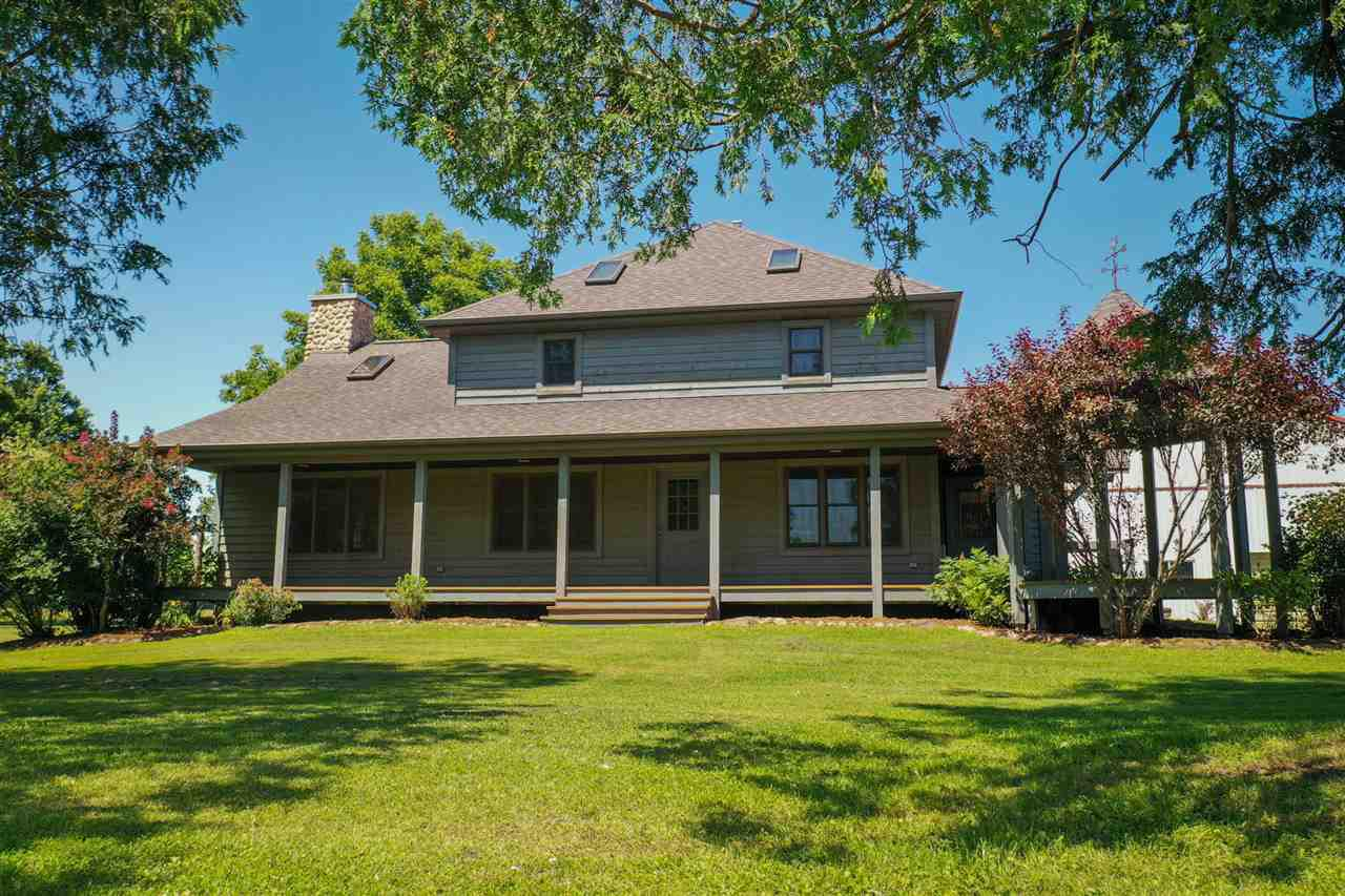 This home was taken down to the rafters & redone 16 yrs ago & is a fabulous country home w/61.18 acres-some tillable, great hunting property w/food plots & woods w/Embarrass River on 2 sides w/4,900? approx. frontage. Wrap-around front porch, a gazebo area & an 80X40 pole shed part used as a 2 car garage w/opener & the rest is wide open for all of your toys! A huge greatroom with Cathedral ceilings & a majestic floor to ceiling stone fireplace-wood burning. 3 beds up w/full bath-jetted tub and separate shower & office or 1 bed on main with a full bath. 1st fl laundry. Lg kitchen w/island.