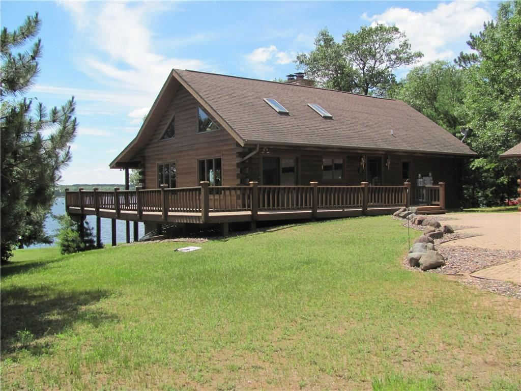This awesome Log home is a must see overlooking beautiful Person Lake.The logs were brought in from British Columbia and masterfully built..The home has vaulted ceilings, beautiful hand made cabinets, 2 stone wood burning fireplaces, wrap-a-round deck, indoor hot tub and sauna plus a brick drive way.The 3 car garage has lots of room for extra toys.Here you have a private lot with spectacular lake views and clear water for swimming and good fishing for Walleye,Bass, Northern Pike and pan fish.This home is a must see.