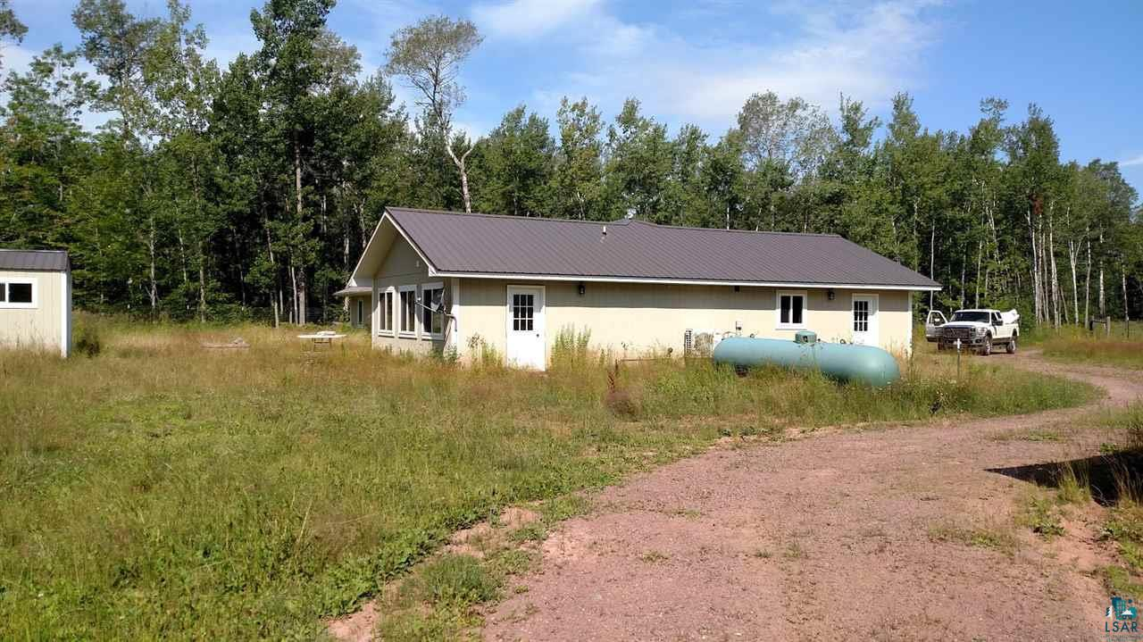 Very unique property on Madeline Island.  This property features 4 bedrooms, 2 bathrooms, nice formal dining area and an eat in kitchen.  Very open concept in the home.  In floor heating with an attached garage also heated. Outside features include a sauna, chicken coop, fenced in areas for animals, with a very large shop with an area for animals, large heated work shop, and an out door lean too for outside storage. Ideal for a small hobby farm.  Out door watering system, for any animal you want.  The large shop has a 64x64 foot print with a 64x40 heated workshop, a 32x12 office with bath and partial living quarters, and 32x12 inside animal facility and a 64x12 lean too for storage.  This property is being sold below actual cost and is a bargain in todays market.
