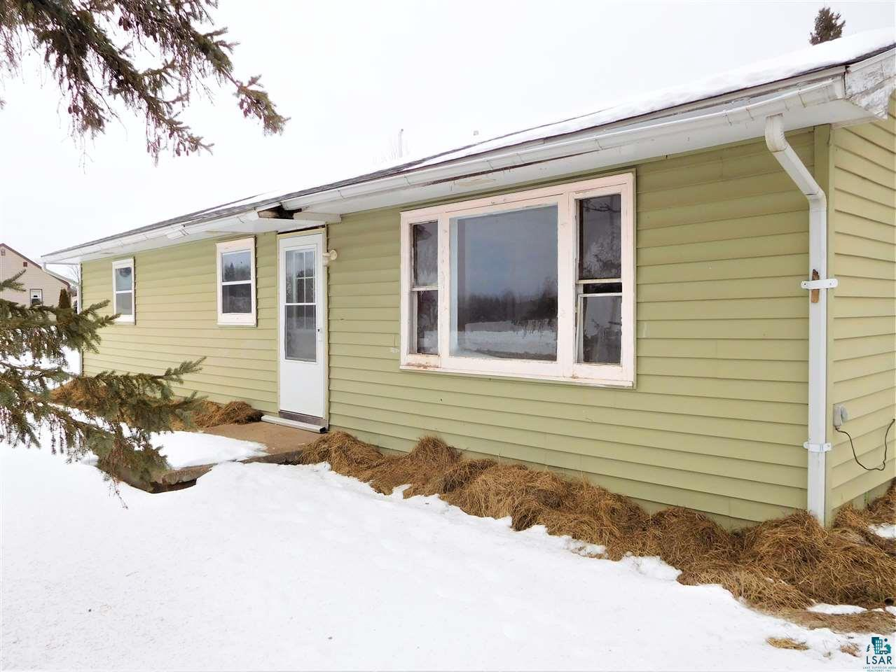 Two-bed, one bath, one level home located on HWY C just off of HWY 13.   Bring your elbow grease & fixer upper attitude and dive in!   The front entry leads into the bright living room and the back entry opens into a mud room.  Eat-in kitchen with breakfast nook. All one level the utility room is just off the back entry. Three buildings out back provide some storage and this property offers a yard that lets you enjoy country living and still be close enough to city amenities. Located near the Town of Marengo this home is just under a fifteen minute drive to Ashland.  Fiber Optic available powered by Norvado.