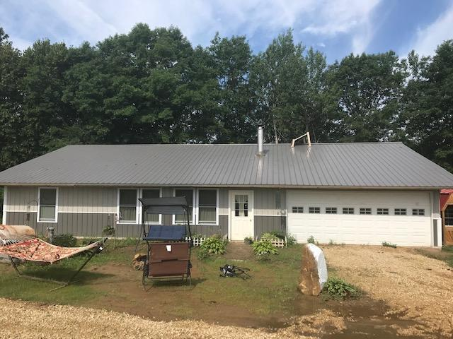 2 bedroom 1 bath one level home built in 2018. Very private, tucked in 6.74 acres with mature trees. Has fenced pasture and a 2 car attached garage. Solar panels not included in purchase. Will make a wonderful home site!