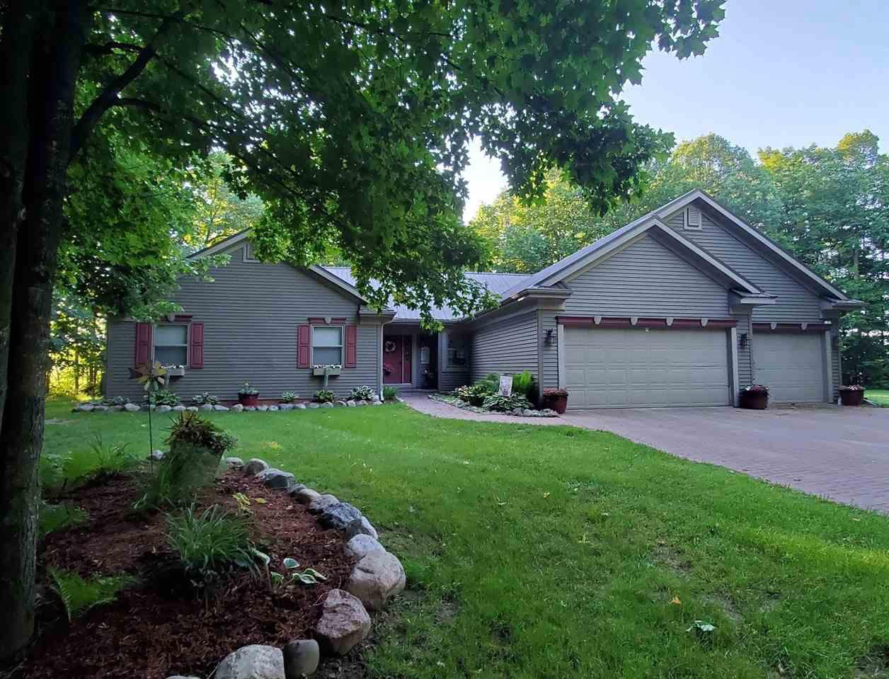 Wonderful privately located home only 1.5 miles from the city limits.  Large master bedroom, bathroom and closet, and large 2nd bedroom with walk in closet. Main floor has spacious rooms with hardwood flooring, including living room with wood fireplace, dining room, kitchen with dinette. Main floor laundry and half bath and back entry off the attached 3 car garage. Lower level has a spacious rec room and large bedroom. Very nice back patio area off the living room.,Newer metal roof! ALL this only a minute or two from town. COME SEE!!