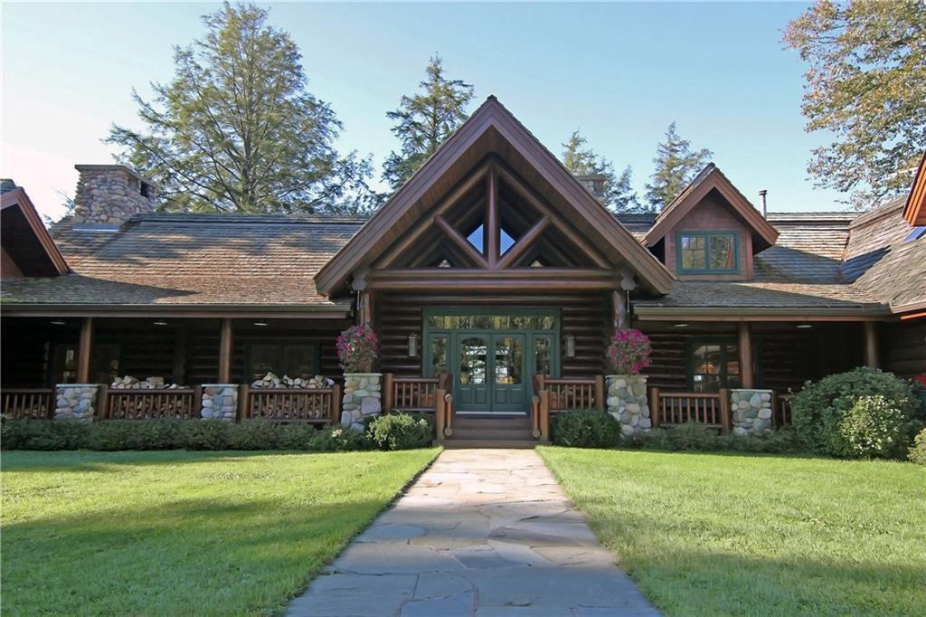 Elegant log estate on crystal clear Diamond Lake. This unique 10,000 sq. ft. Adirondack style retreat boasts natural fabric wall coverings, indoor and outdoor saunas, log boat house with observation deck, Australian cypress flooring, vaulted ceilings, copper screening, oil rubbed bronze hardware, massive split granite fireplace, newly installed fiber optics, 850? of wooded shoreline and 25 acres. No expense was spared. There are 4 fireplaces each unique and offer excellent ambiance in the master suite, great room, dinning room and billiard room. The kitchen space will satisfy your best epicurean ideas. Chapinwood is bold, beautiful, comfortable and private, created for future family generations. Property offered unfurnished. Certain furnishings and equipment available by separate contract after acceptable offer.