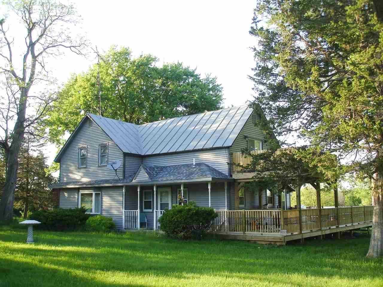 """Farmette"" with 11.15 acres and a Folk Farm House that has been completely redone inside and outside.  The home is beautifully decorated and has all brand new appliances.  Expect to be impressed.  Maintenance free exterior with a brand new deck (up and down).  The outbuildings are structurally sound and could be fully  functional with some TLC.  Main barn is 40'x80' with 2 stalls. Very nice location, great house and wonderful acreage."