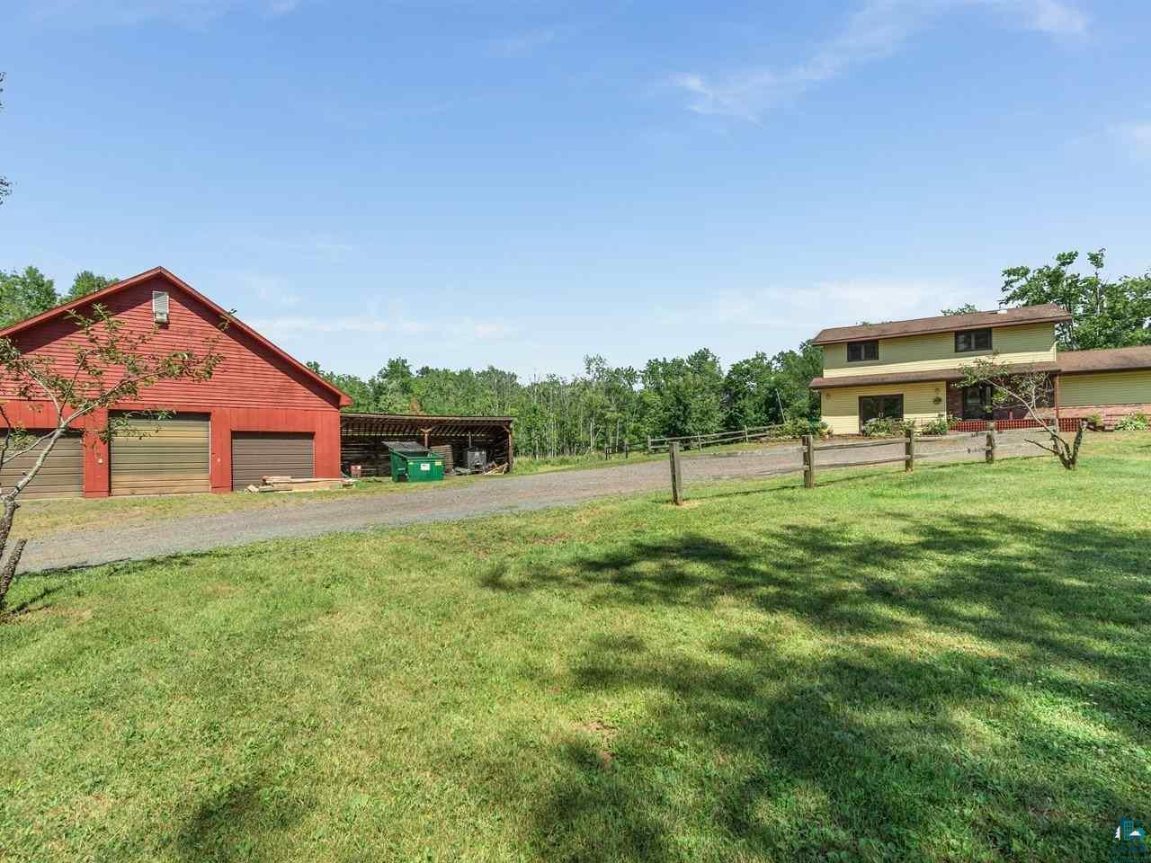 Enjoy country living just 11 miles from town in this completely updated 2-story home on 40 acres. The house includes 4 bedrooms & 3 baths and features a sunken master bedroom with a spacious full bath, including a steam shower & separate jetted tub. There's newer oak flooring throughout the main level, including the spacious living room with its bay window. The gorgeous custom kitchen features cherry cabinets, granite counter tops & stainless appliances. The adjacent dining space can fit a large table and has patio doors to a nice deck. There's also a main floor den the could also be used as a smaller family room or TV room. From here you can access a 2nd deck off the back of the home. A powder room & main floor laundry complete the main level. The upstairs features 3 bedrooms & a full bath. The bedrooms all have oak flooring & nice closet space. The largest has a walk-in closet. The lower level boasts a huge rec room that is mostly finished (just needs a ceiling & lighting). The homes forced air heating system is propane fed but can also be run off an outdoor wood boiler. Need space for toys? There's a wonderful 36x50 heated garage that will fit 3 large vehicles & includes a 36x21 shop in the rear & loft storage. This property would make a great hobby farm with its 36x20 barn, lean-to & several steel sheds for storage. There's even a pond with a fountain!