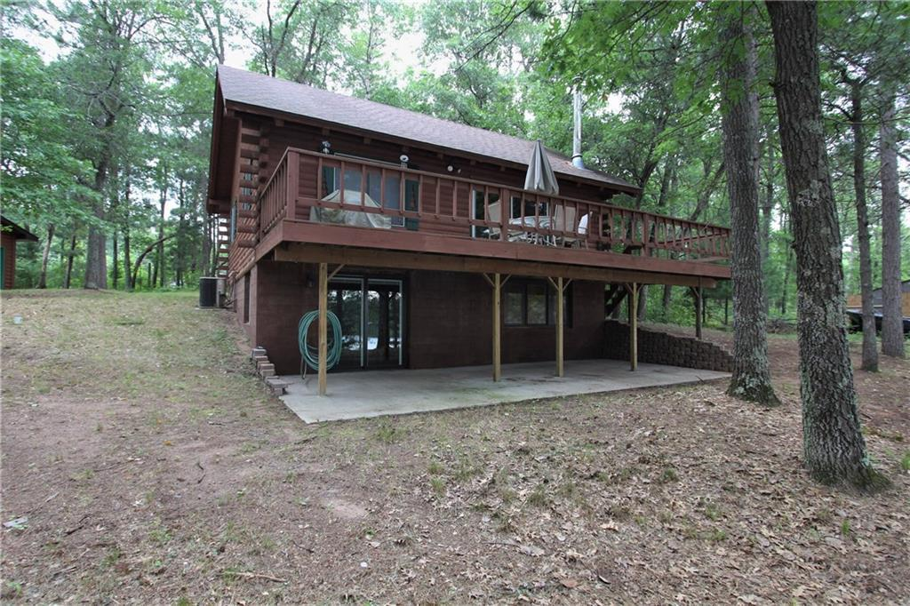 CABIN LIFE- Enjoy 4-seasons in Burnett County with this updated log cabin and 127 feet of sandy shoreline on beautiful, quiet Lucerne Lake with 2 bed/2 bath and large open loft. Finished lower level with walk-out and large deck. Large oversized 2-car garage plus a single insulated/heated garage for toys or year round workshop. Cty Rd H is ATV friendly, so hit the trails right off your property- ride safe!