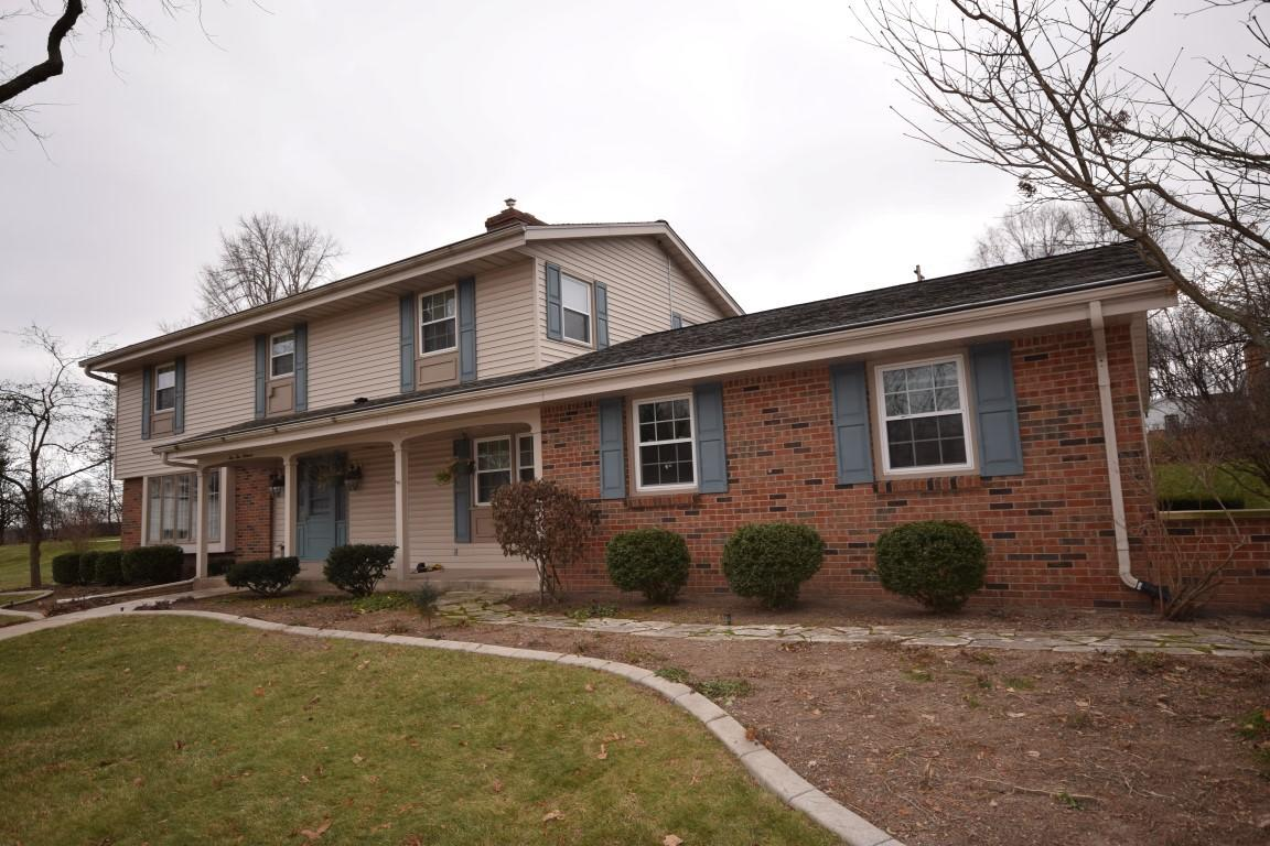 Come see this well maintained 3000+ sq ft 4+ BR, 3.5 BA home located at the end of a quiet cul da sac in Kewaskum.  Features include brand new solar panels on the roof of house and garage to help on utilities, updated kitchen with granite counters, hardwood floors and tons of cabinets, family room with brick fireplace, beautiful heated sun room with skylights, huge lower level with egress window, 2nd kitchen, rec room, full bath, and office. Upper level with 4 nice sized bedrooms, 2 full baths,& laundry room.   Large backyard with creative curbs landscaping & nice sized patio. Adjacent to the new Reigle Family Park.  Call today!
