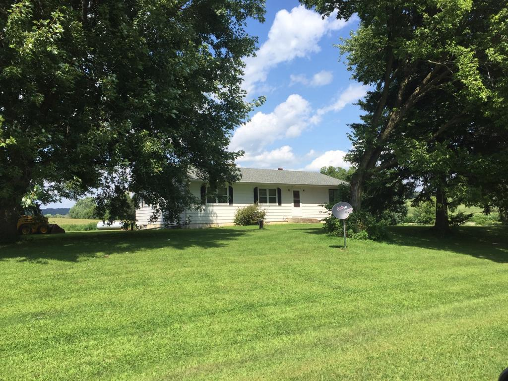 Secluded Home with Numerous Outbuildings and approx 9 Acres.  A Hobby Farmers Dream.  Home offers 3 Bedrooms, 3 Seasonal Porch. Newer Furnace and Central Air Conditioner. Mobile Home has Full Basement and Own Septic and is presently rented.