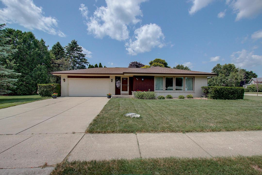 This well loved and maintained ranch home on a corner, fenced-in lot is just waiting for its new owner to add their own personality.  The roof was replaced in July of 2019 and the exterior of the home is maintenance free.  The windows and doors have all been updated.  The kitchen cabinets, flooring and counter-tops were updated within the last 10 years.  There are hardwood floors under the carpet in the bedrooms, the living room and dining room.  This home is in a great location for easy access to shopping, parks and Interurban Trail.Home Warranty included.