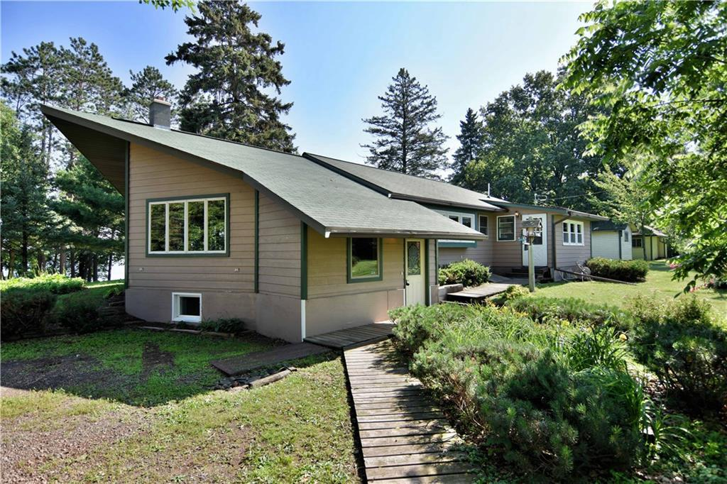 Capture this family compound style living, (originally a resort) located on 357 ft (est)  sandy bottom on 66 ft deep, 569 acre Mud Hen Lake.  The Main Prow front Home is delightful &  cheery boasting remodeling in 2000, windows, siding & Insulation, roof, septic w/drainfield, appliances, 2010 water heater, etc.   the garage roof is brand new a week ago!  Spacious family room with gas fireplace;  expansive, flowing main level with dining & living area, custom kitchen cabinetry  & pantry, and laundry with mudroom entrance.  Sleeps many in the 2+ bedroom as lower level can be bedroom, crafting room, with more space to finish off if desired. Three separate bunkhouse cabins brings you back in time to the Good ole days, providing privacy & weekend fun for the guests & family. What a get away for all!
