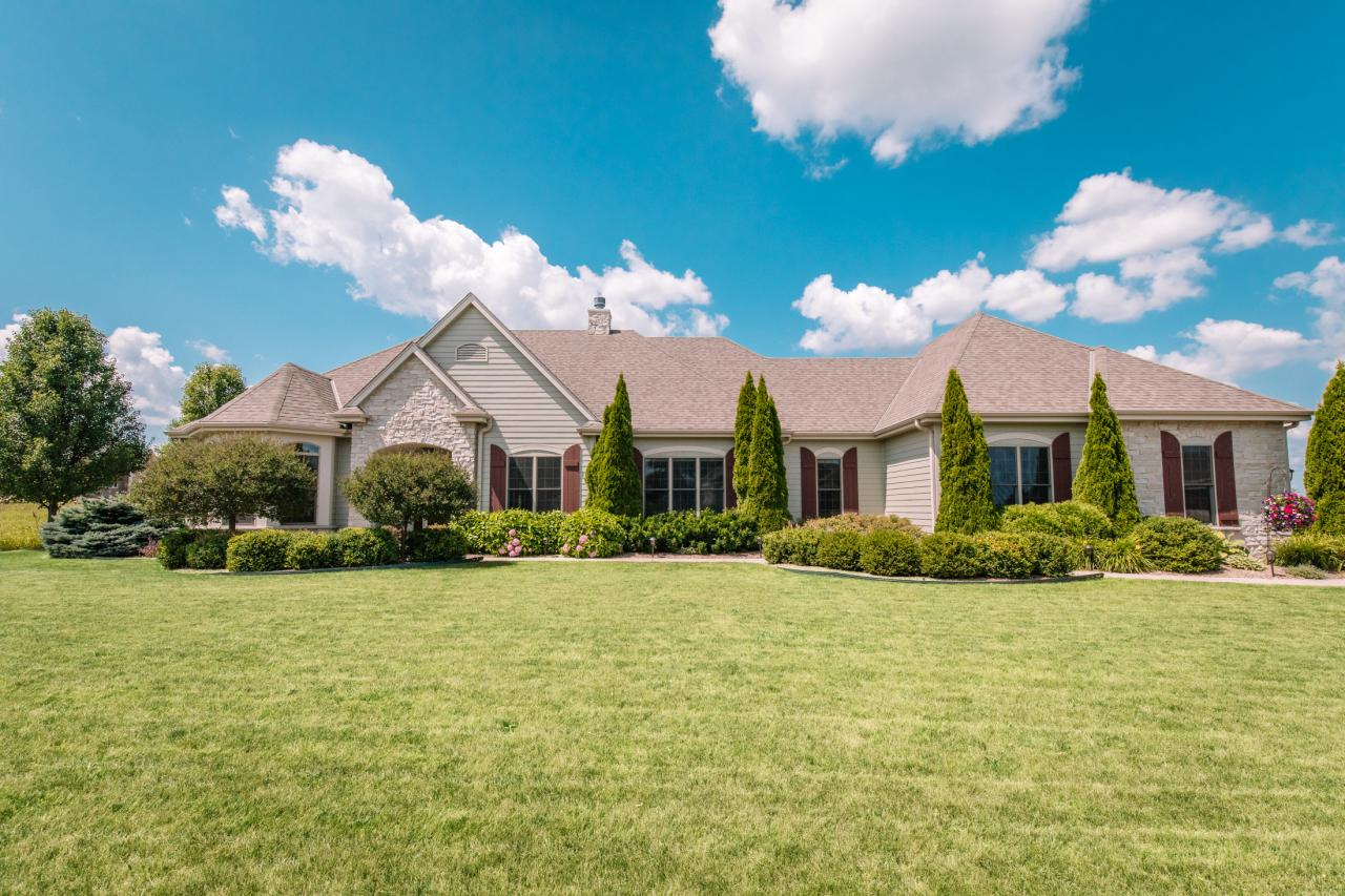 Sunny open concept newer Embassy built Ranch in a gorgeous country setting. Beautiful living room and dining room with arched entries. You'll love the gorgeous built-in china cabinet in dining room with hardwood floors. Sensational open kitchen with dinette to family room. Kitchen features newer granite counters, stainless steel appliances, large pantry and island. The generously sized family room has  a gorgeous gas fireplace and great views of the private backyard. Private master suite offers an updated bath with a walk-in shower and soaking tub. Two other bedrooms and another bath are available for your guests. Large first floor utility/mud room. A great floor plan and special touches make this home special. What a treat! HSA Home Warranty.
