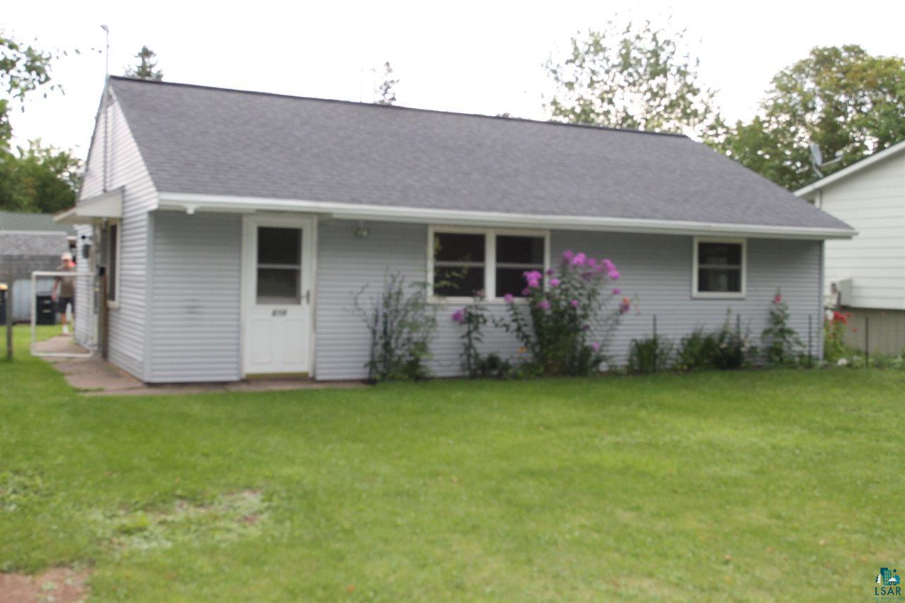 Clean, one level house conveniently located on a quiet side street.  2 Bedrooms, open living room/dining room, kitchen, large utility/laundry room, 1 full bath. Shared furnace and coat closet helps dry jackets and shoes in the winter.   New refrigerator, Trane gas furnace and gas water heater in 2018. New paint in 2018-19 and lots of other small improvements.  Washing machine included and hookup ready for electric dryer. Central air.  Storage shed has electric light and outlet, New roof in 2018.  Off street parking for at least 2 vehicles, fenced yard, fenced flower beds on both sides of the house with assorted perennials, outdoor spigot, fire pit.