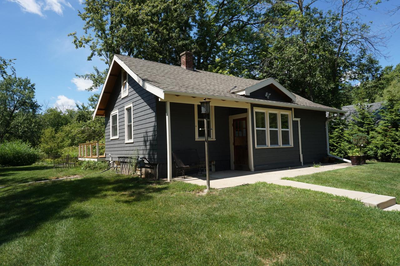 Cute Home on the Scenic Milwaukee River.  Kayak down the river in the summer and ice skate in the winter.  Almost an Acre and approx. 85 ft. of Frontage.  Full of Charm and Character.  Beautiful Hardwood flooring, fantastic views of the River.  Huge Wooded Lot.  Room for a Garage.  Needs some finishing touches and a little TLC.  Location, Location, Location.  This feels like ''Up North''.  Property Sold in ''AS IS'' Condition.