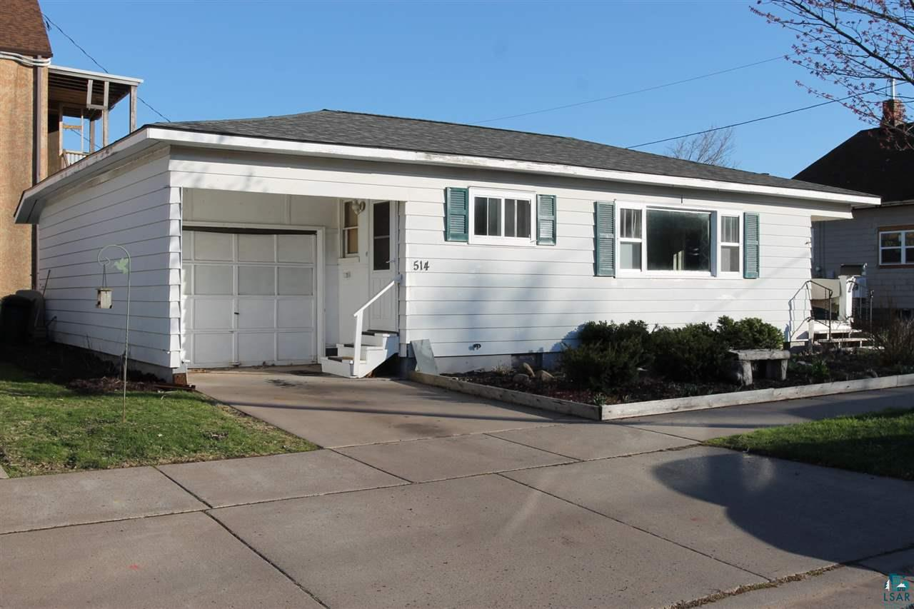 Perfect 2 bedroom Bungalow with an updated kitchen and bathroom.  Full poured dry basement for additional living space.  One car attached garage.  Close to downtown and only 3 blocks from the lakewalk.