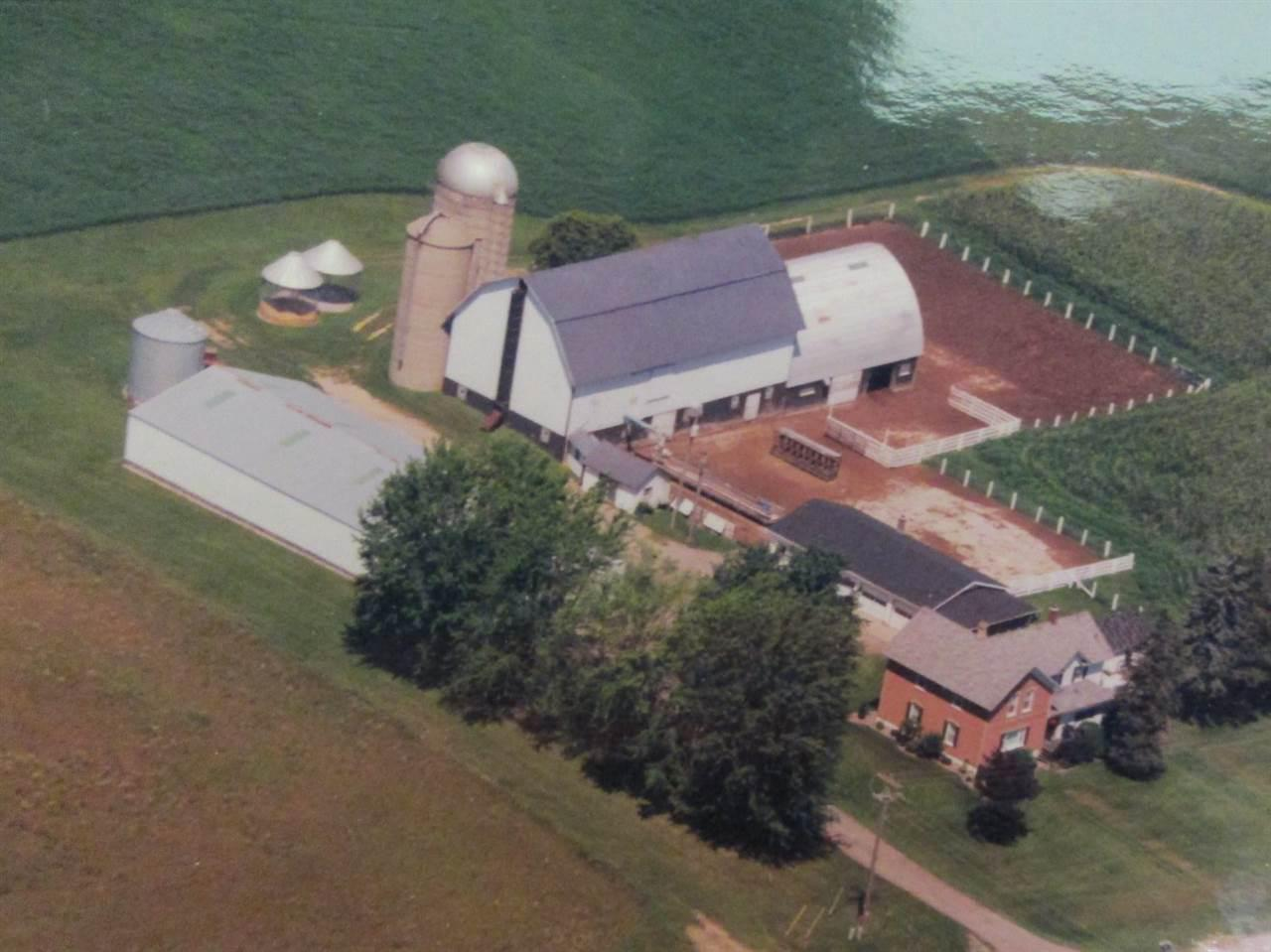 Rare find - 6 acre  Zoned agricultural or commercial.  Large 5 bedroom country home, with 10' x 11' sitting room and a finished basement.  45' x 112' steel pole building, 40' x 80' barn with 40' x 50' addition, 2 corn cribs, grain bin, 2 silos, milk house, tool shed, 36' x 52' four-car garage, with 10' x 26' screened patio.  More land is available.  Great opportunity to live where you have a business, or farm it.