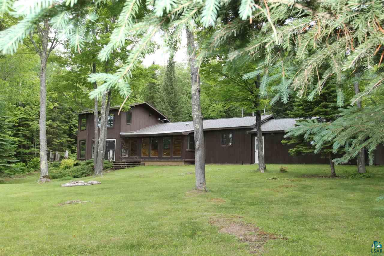 Located between Washburn and Bayfield on Lake Superior!  Unbelievable views of the Islands and the Lighthouse.  3 bedrooms, 1 1/2 bath, main floor laundry, and a large sun room overlooking the Lake and property.  Attached 2 car heated garage.  Private setting on a dead end road.