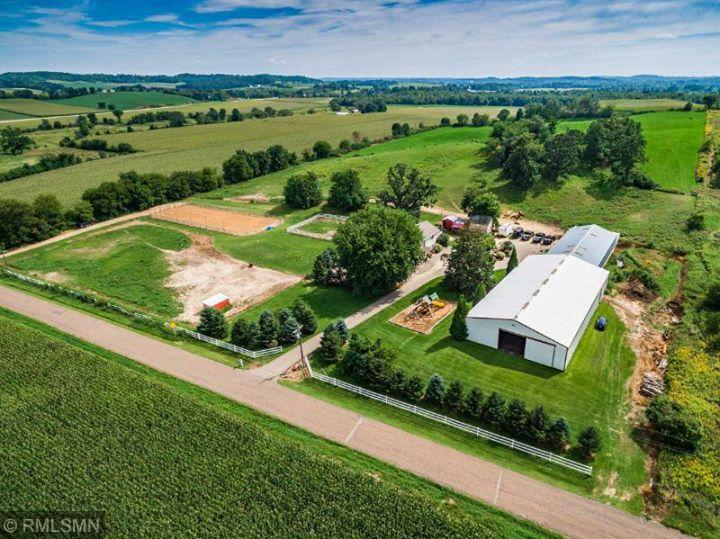Here is your opportunity to own and run your own horse boarding/training facility or Wedding and/or Event Center.  Located just 45 minutes from the Twin Cities.  Easy freeway access, beautiful 10 acre setting.  Fully remodeled 2 story farmhouse, amazing owners suite w/stone fireplace and private deck.  70x180 indoor arena, 60x130 lighted outdoor arena, 96x40 stall barn complete with 15 box stalls, tack room, grooming areas & lounge/viewing overlooking arena.  Truly a must see.  Additional land available.  Subject to survey.
